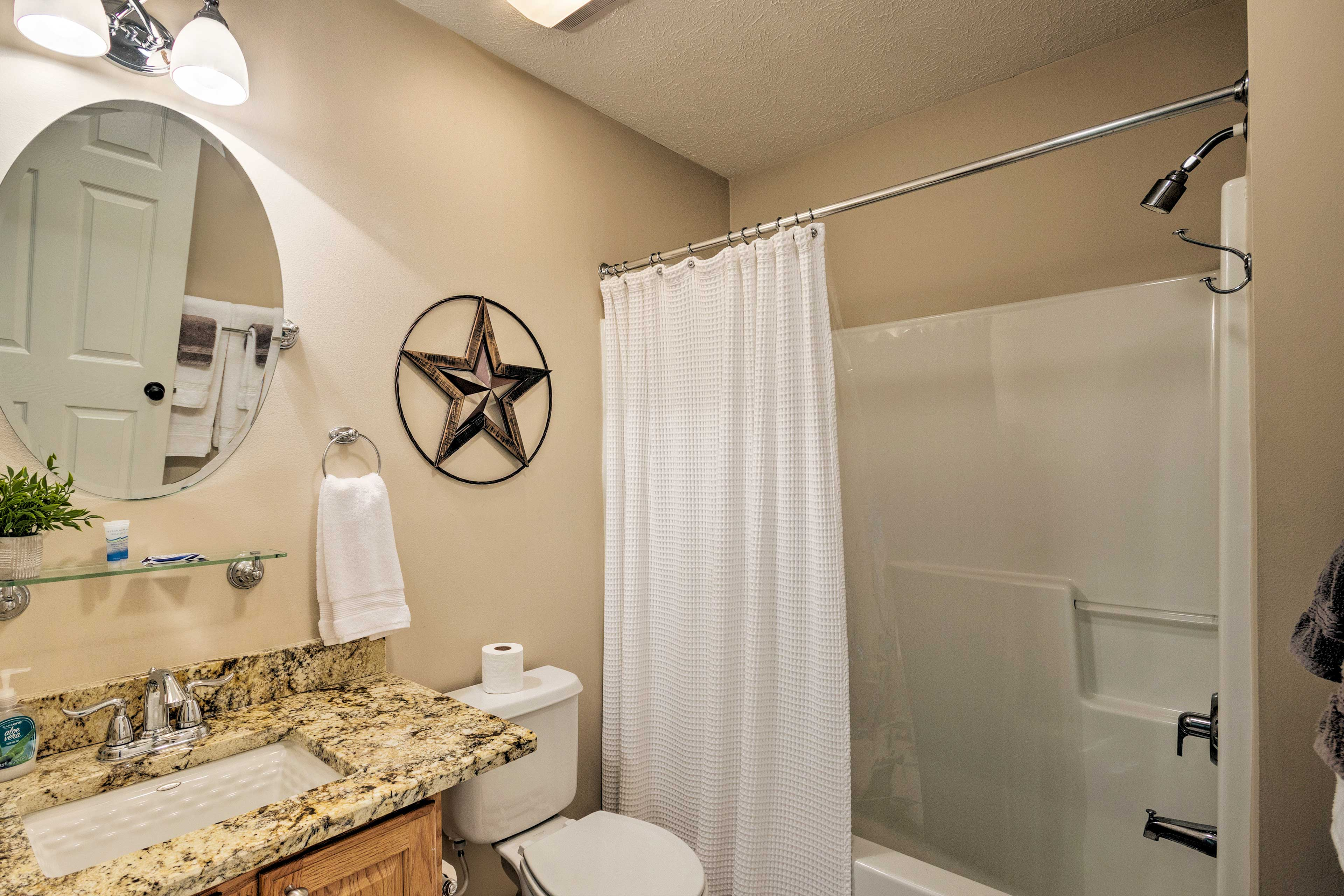 Rinse off in the shower/tub combo in this second bathroom.