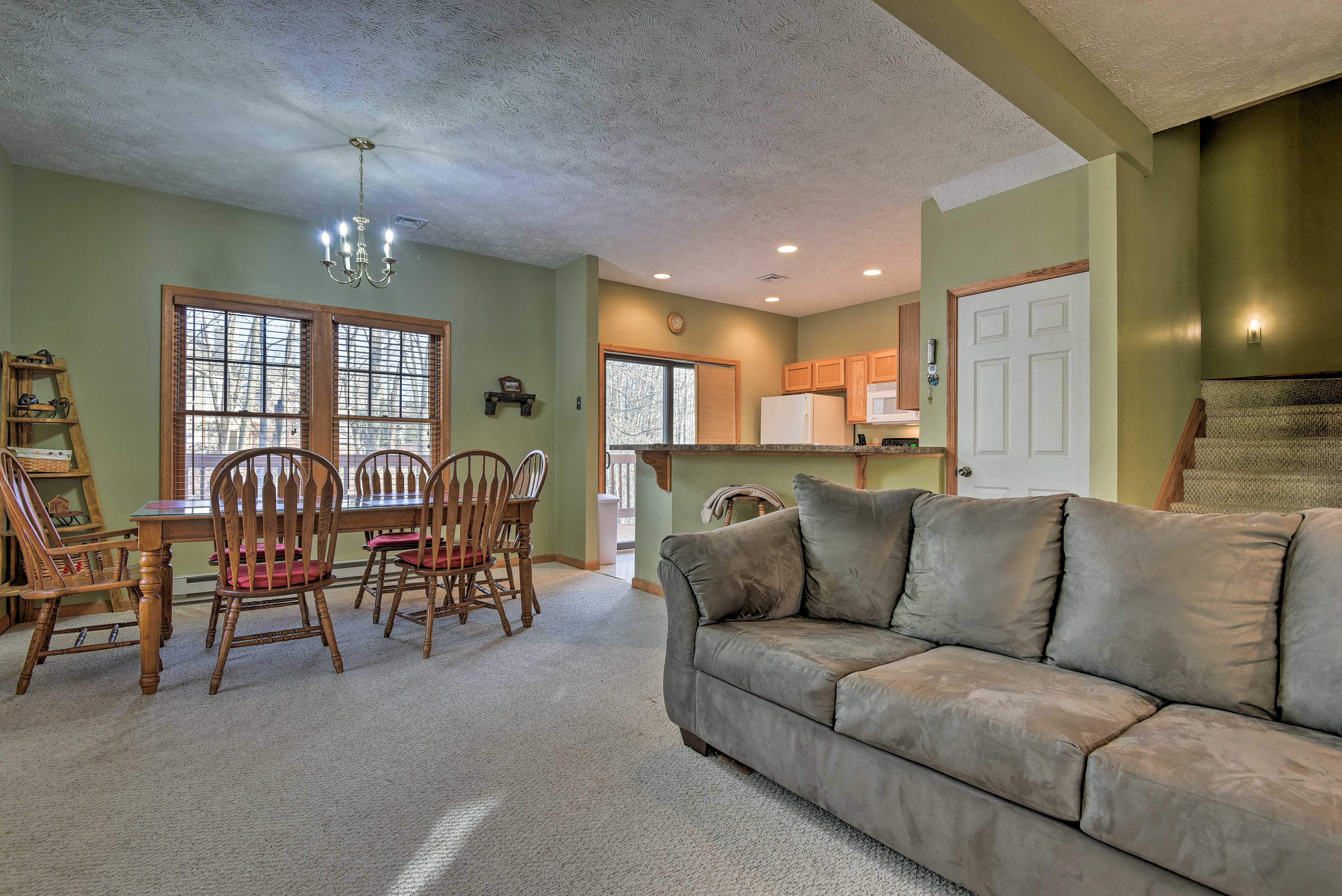 Relax on the comfortable living room sofa and watch the flat-screen Smart TV.