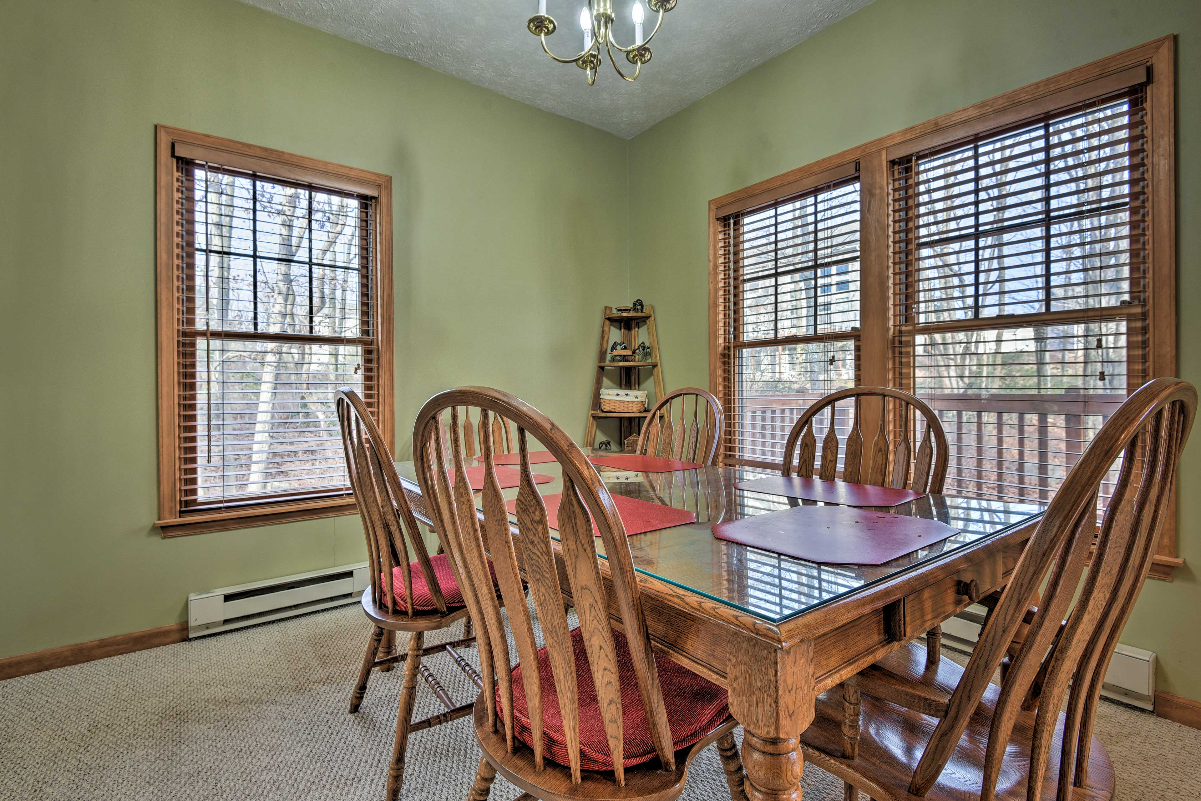 Enjoy a family-style meal at the corner dining table.
