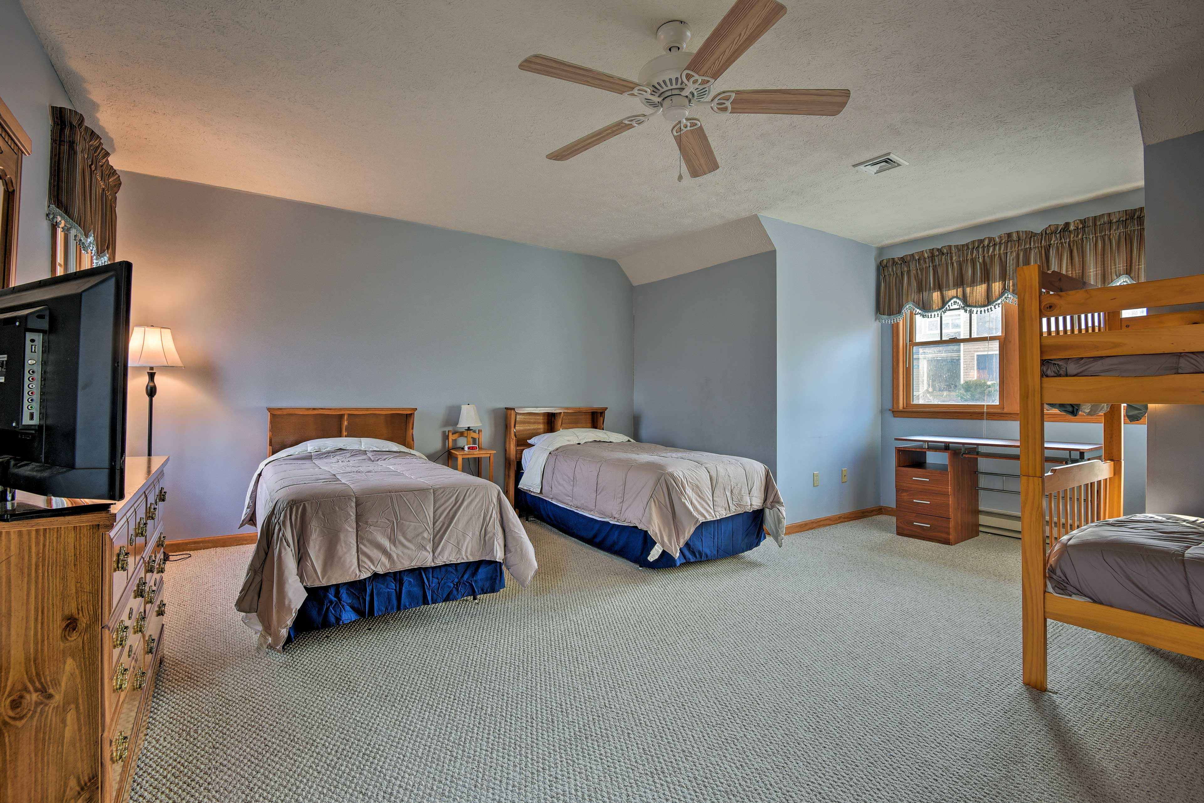 The loft has 2 twin beds and a twin-over-twin bunk bed.