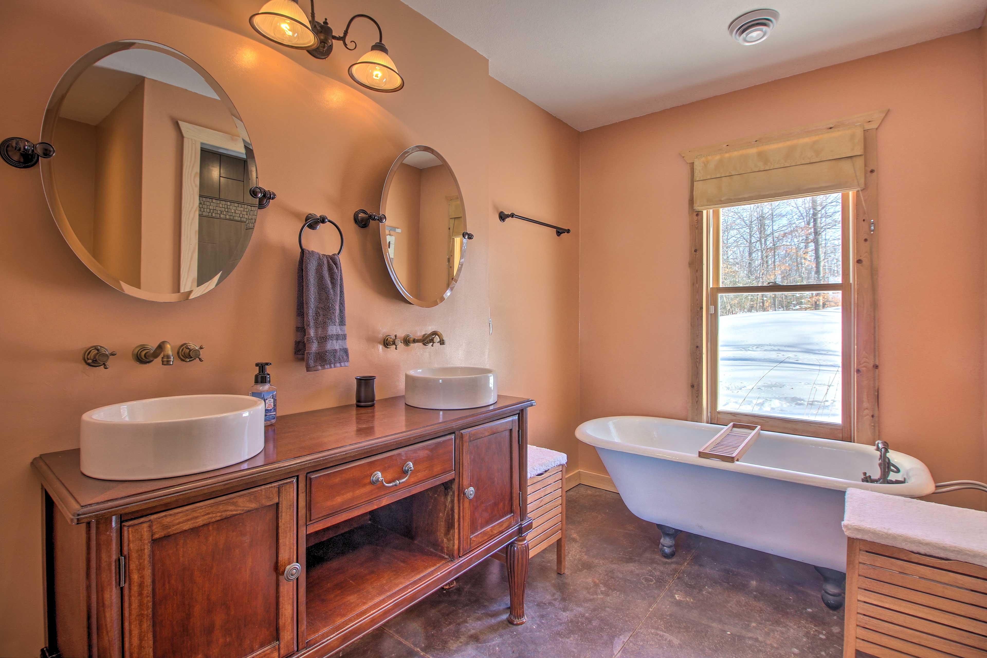 The master bedroom features an elegant en-suite bathroom.