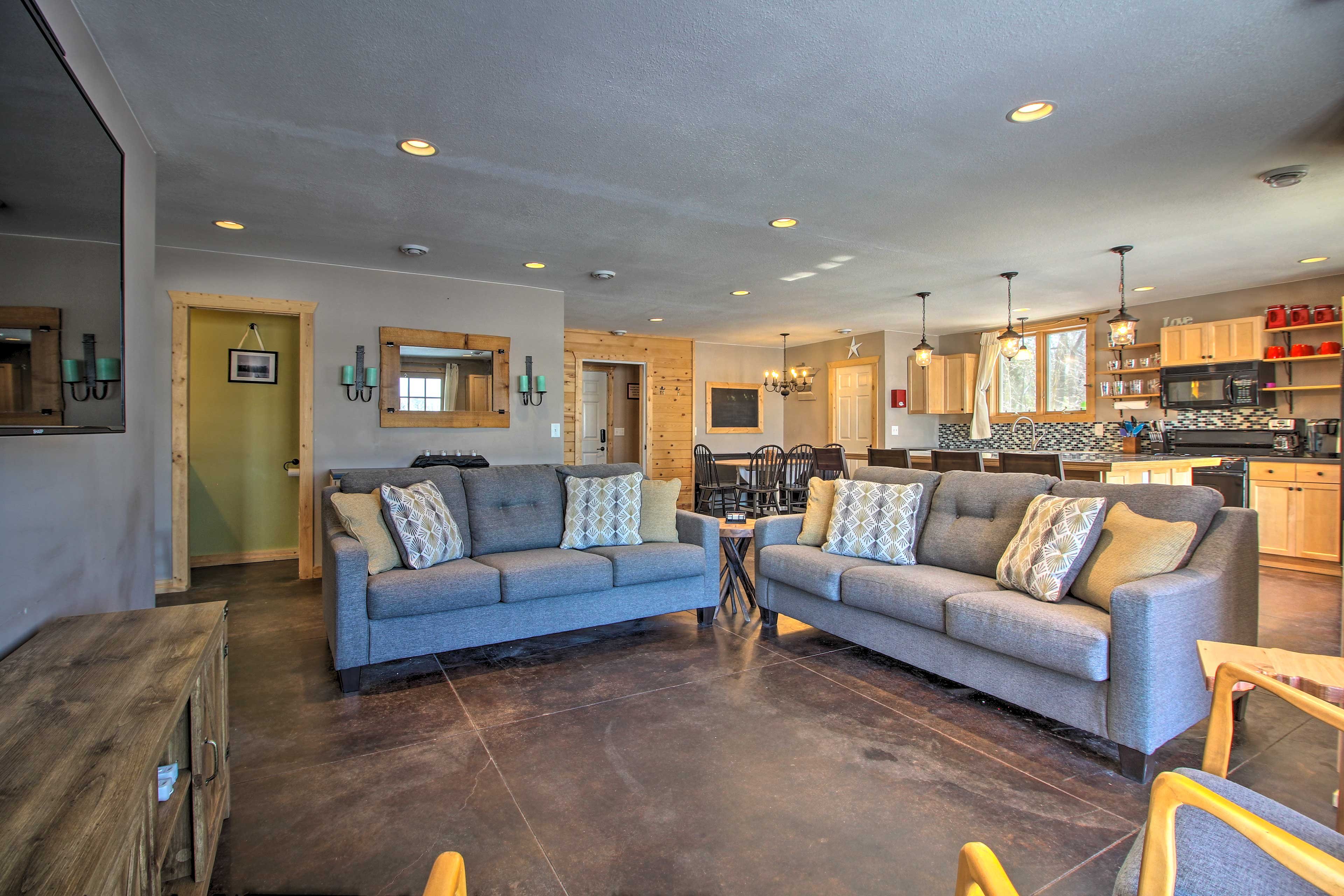 The spacious living area is the perfect room to convene as a family.
