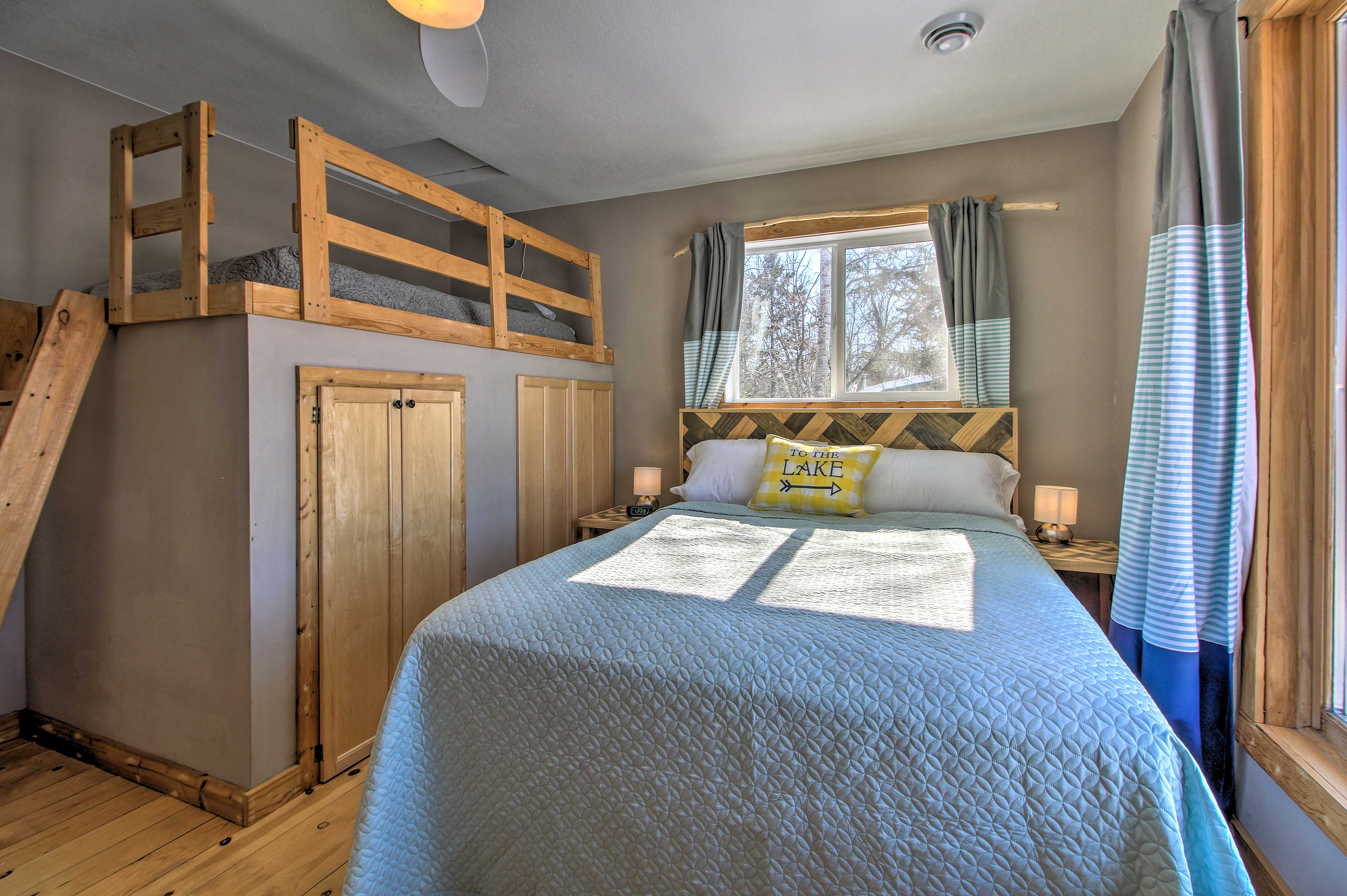 Bedroom 2 is outfitted with a queen and lofted twin bed.