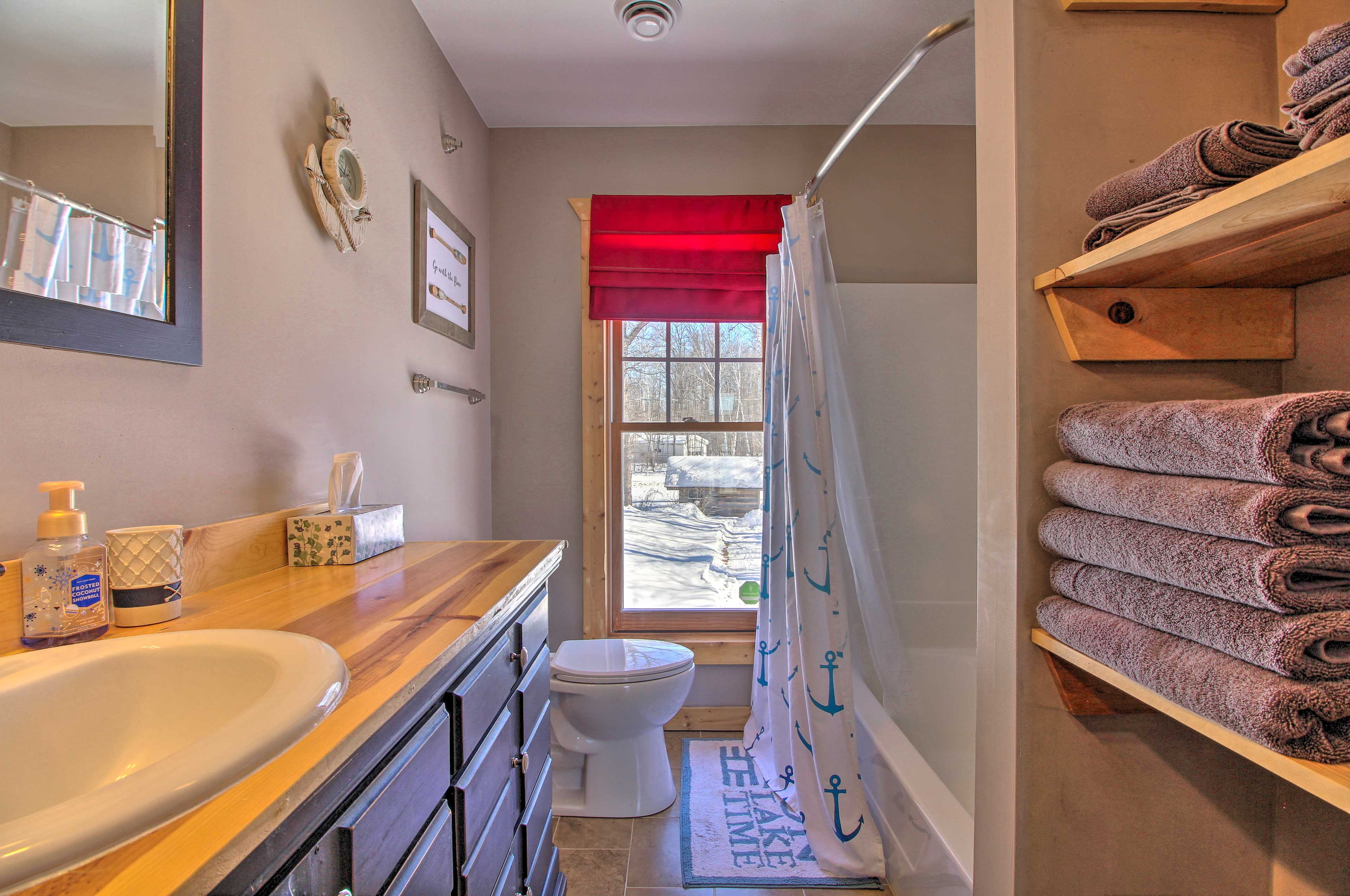 The final bathroom offers a shower/tub combo.