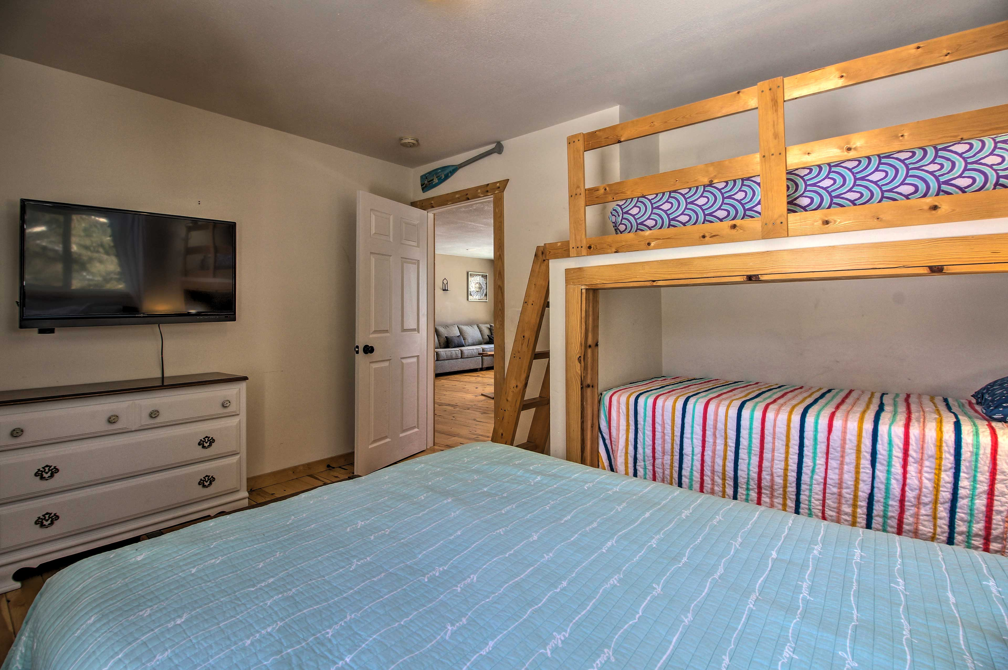 Watch a movie from the comfort of the full bed or twin bunk!