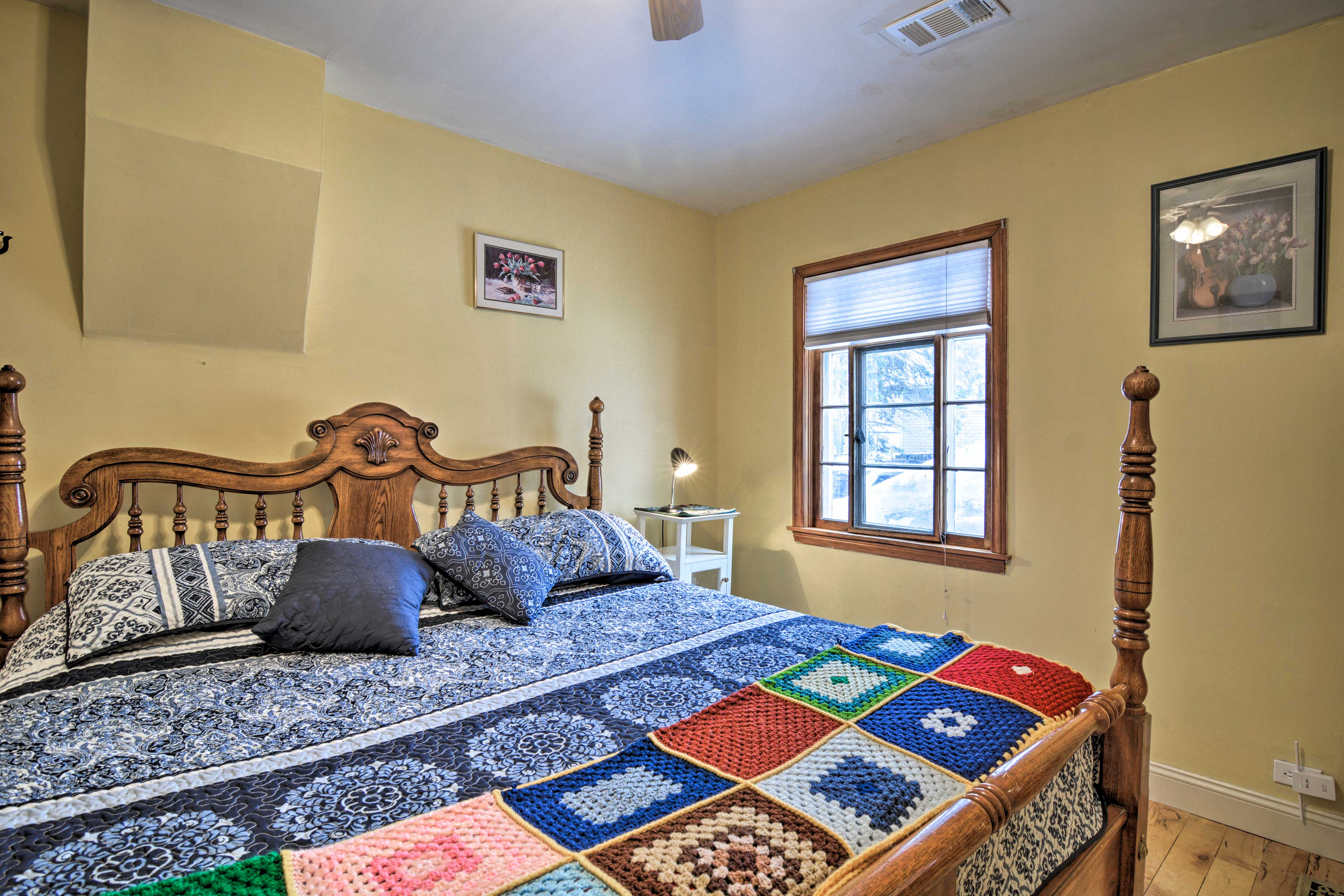 The second master bedroom features a queen-sized bed.