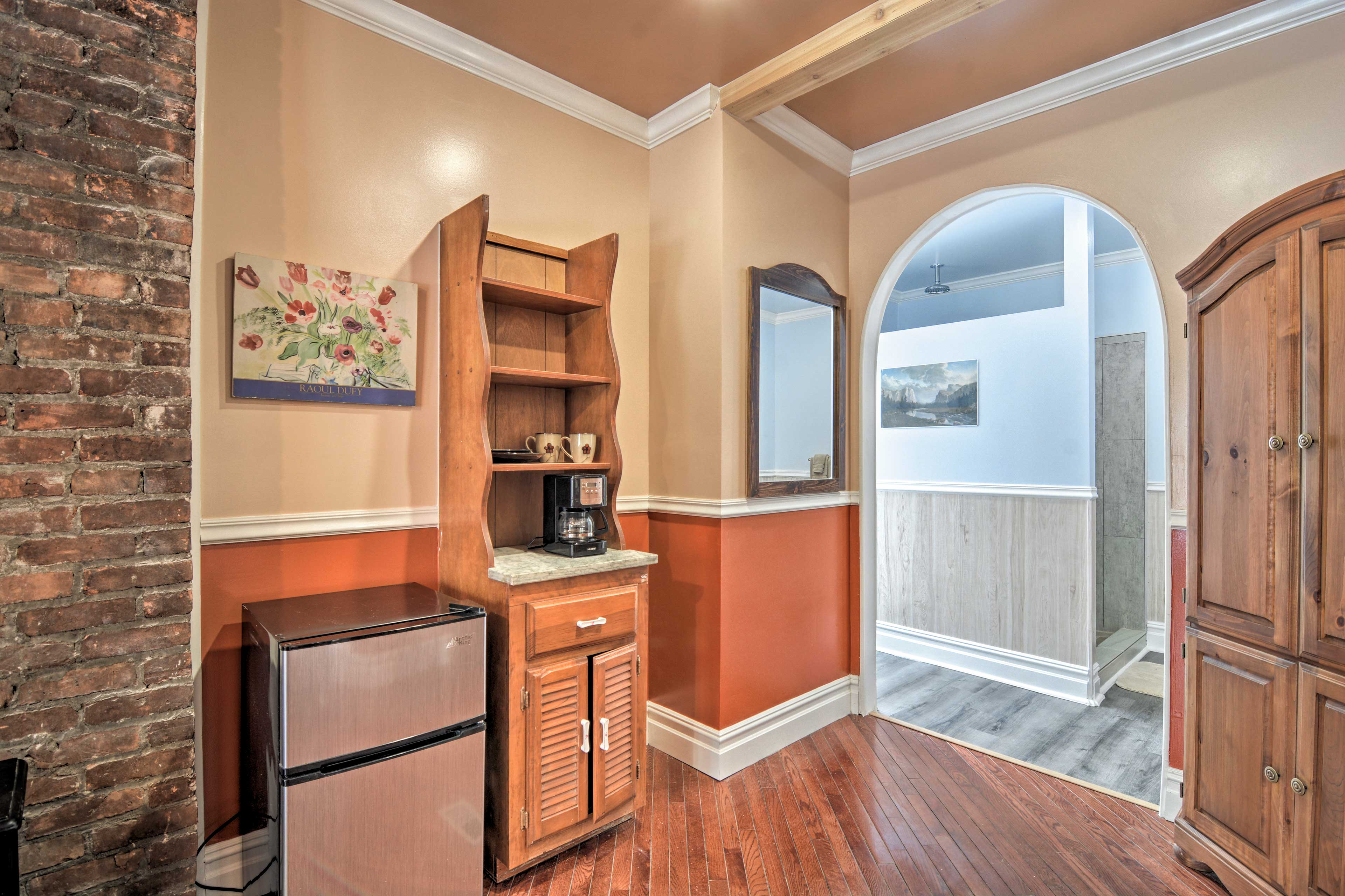 The master bedroom also features a kitchenette and electric fireplace.