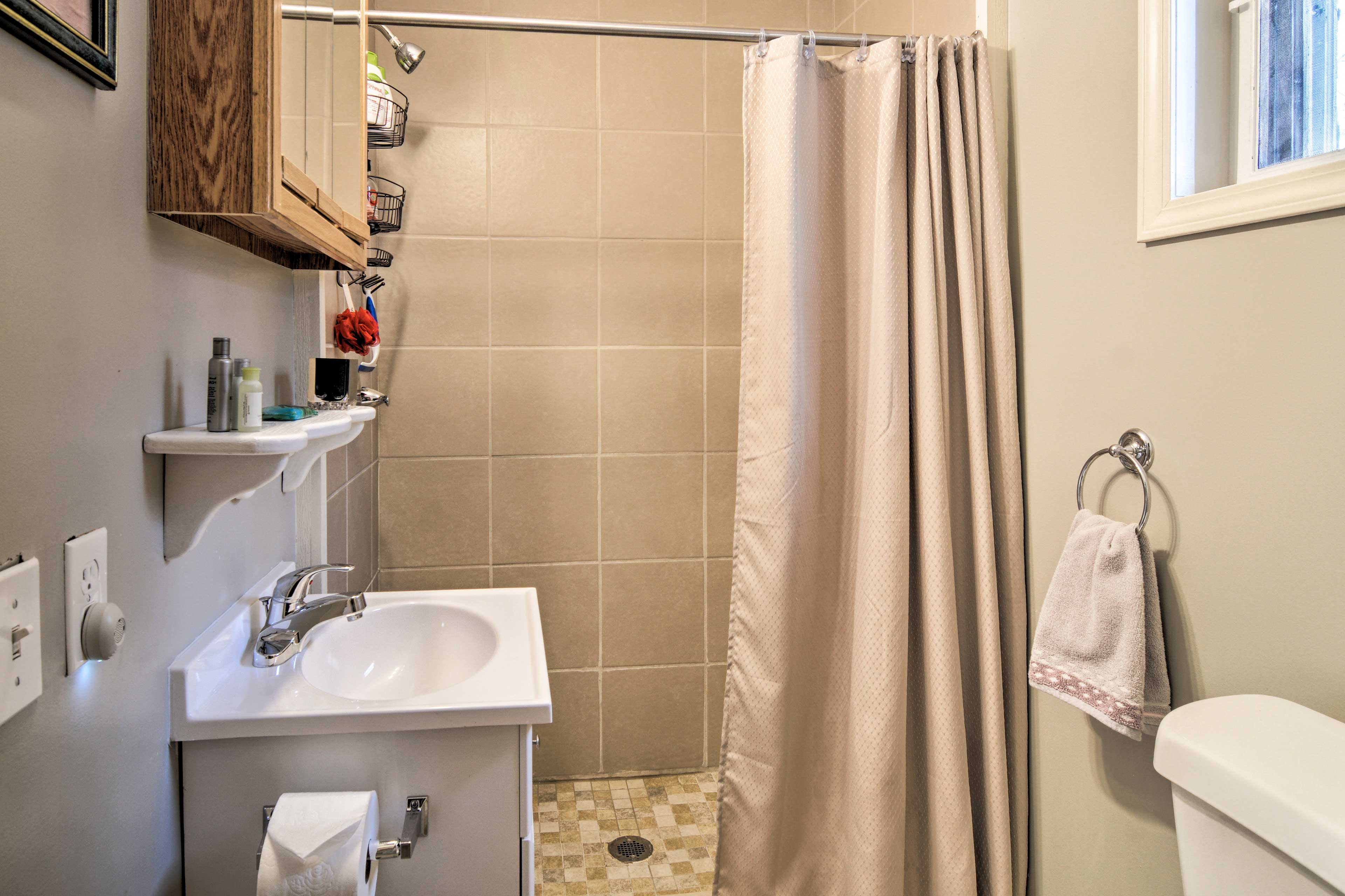 The second full bathroom features a walk-in shower.