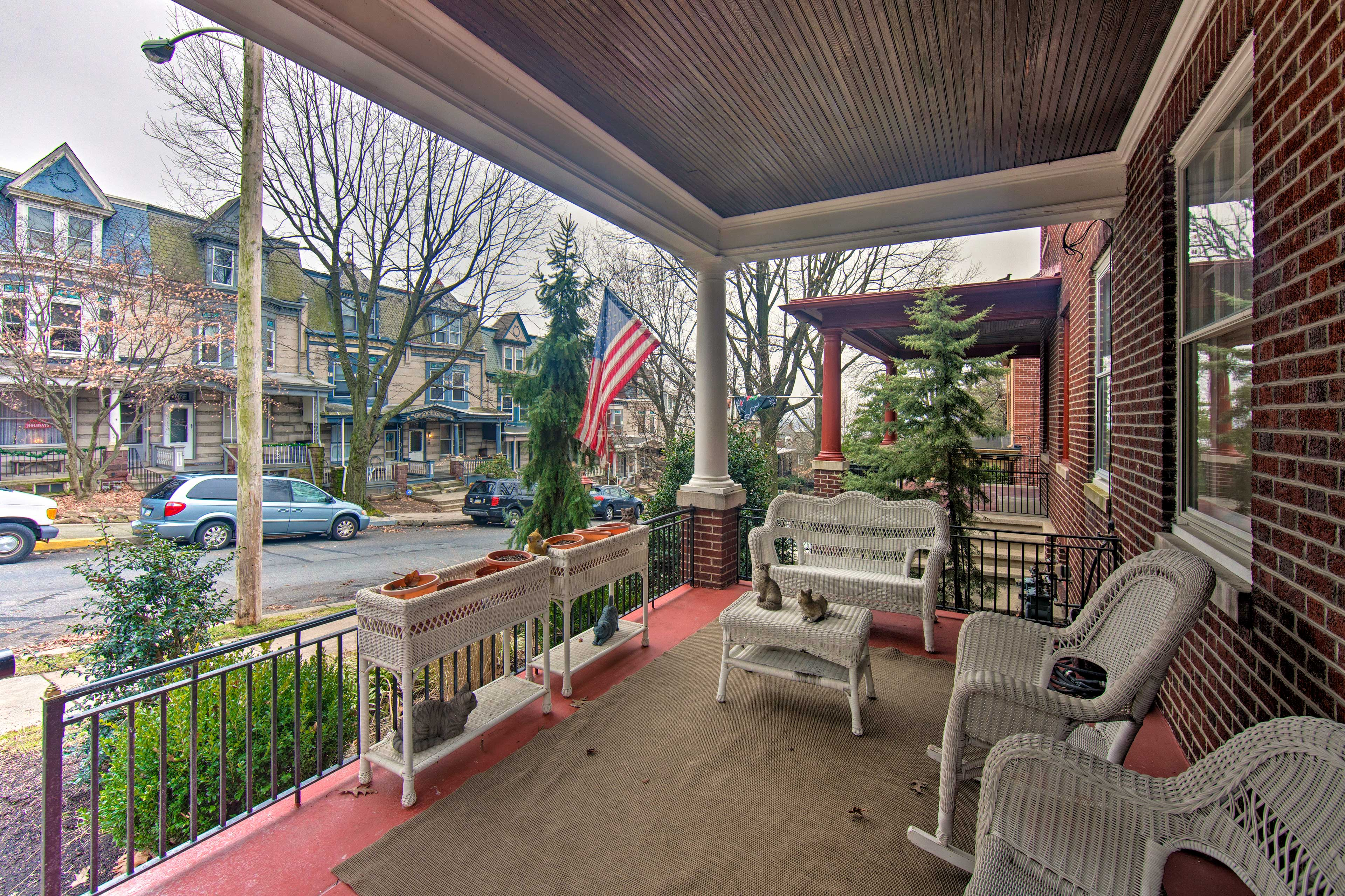 Relax on the front porch of this vacation rental home.