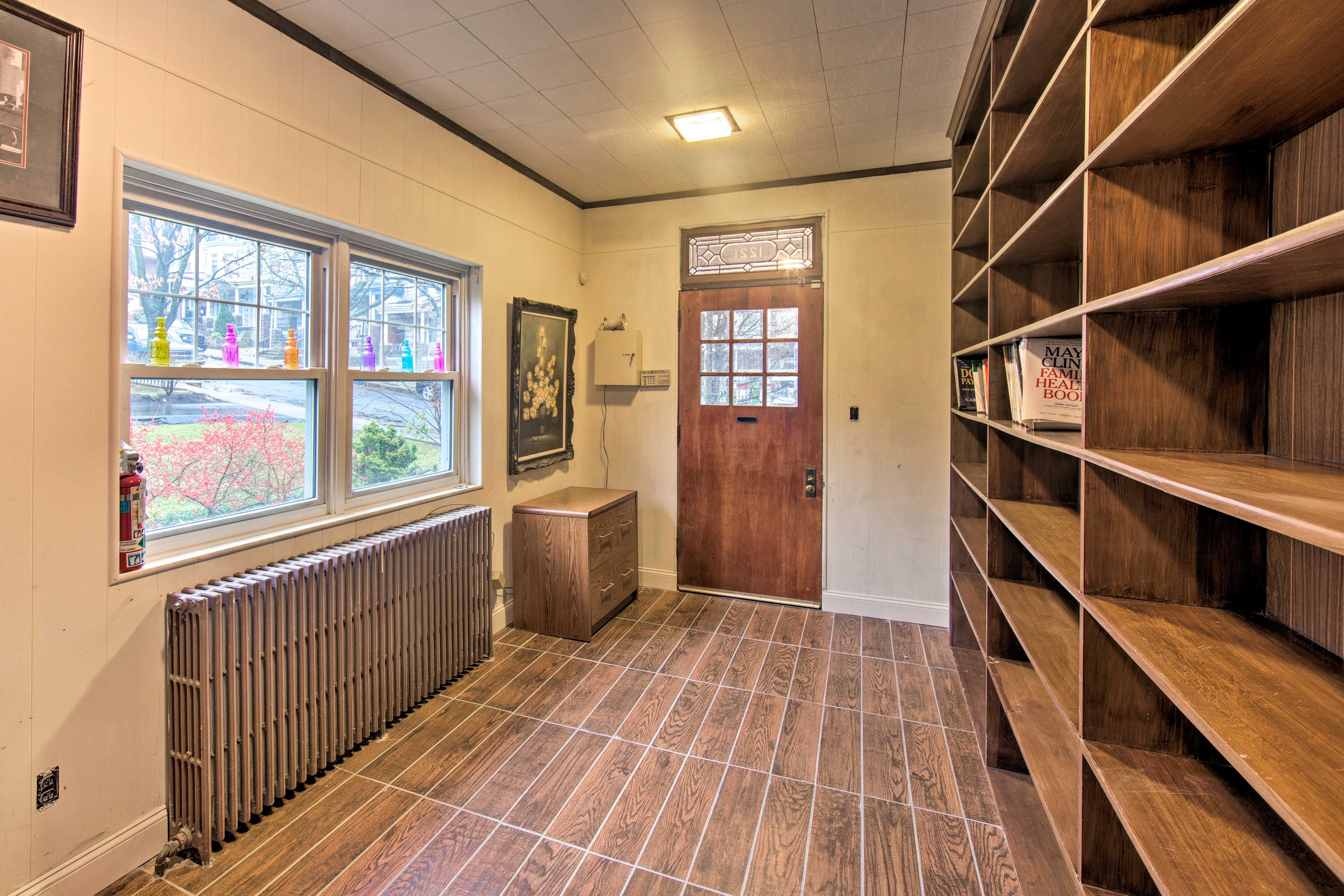 Peruse the books on the shelves in the mud room.