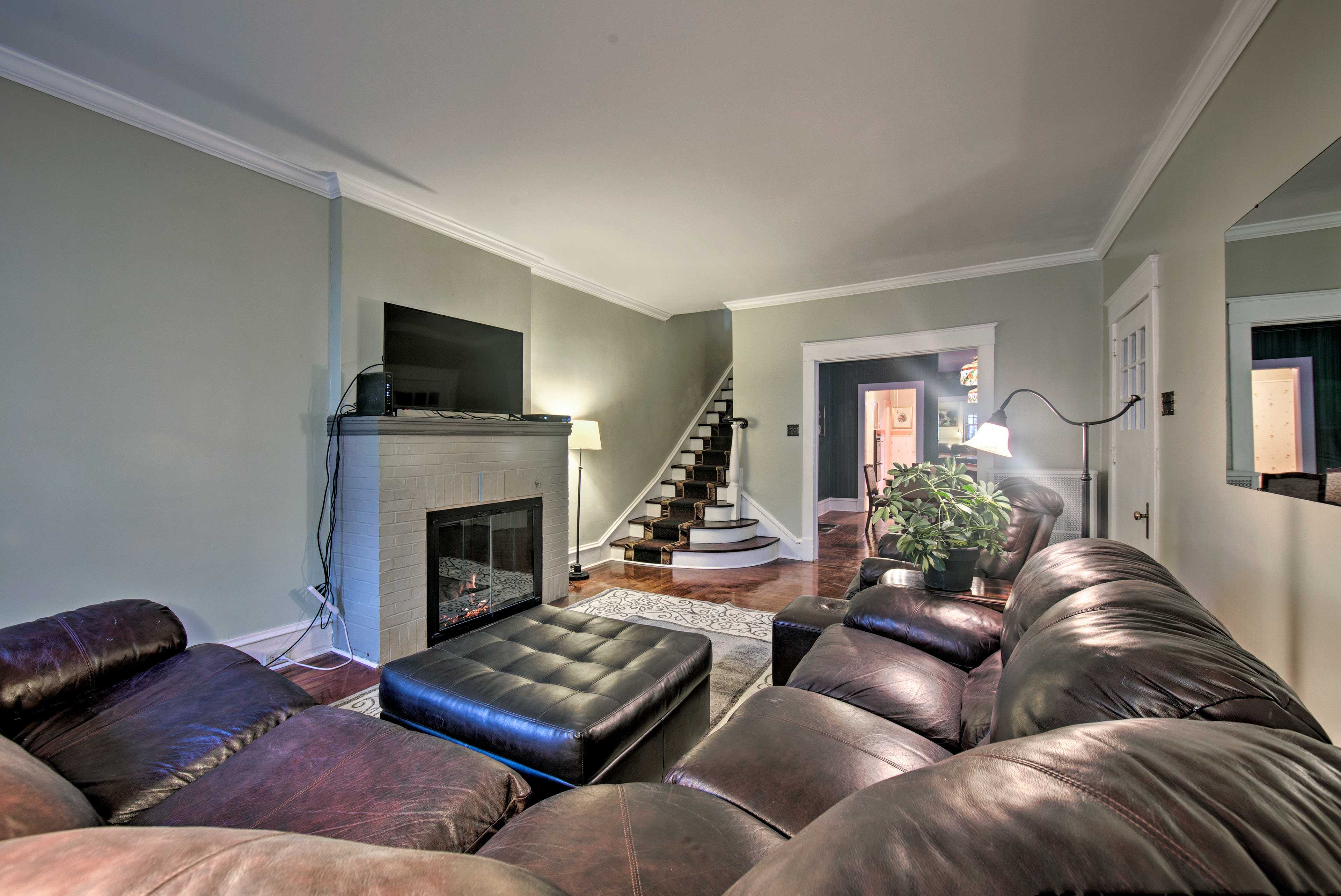 Watch a show on the flat-screen TV while warming up by the fireplace.