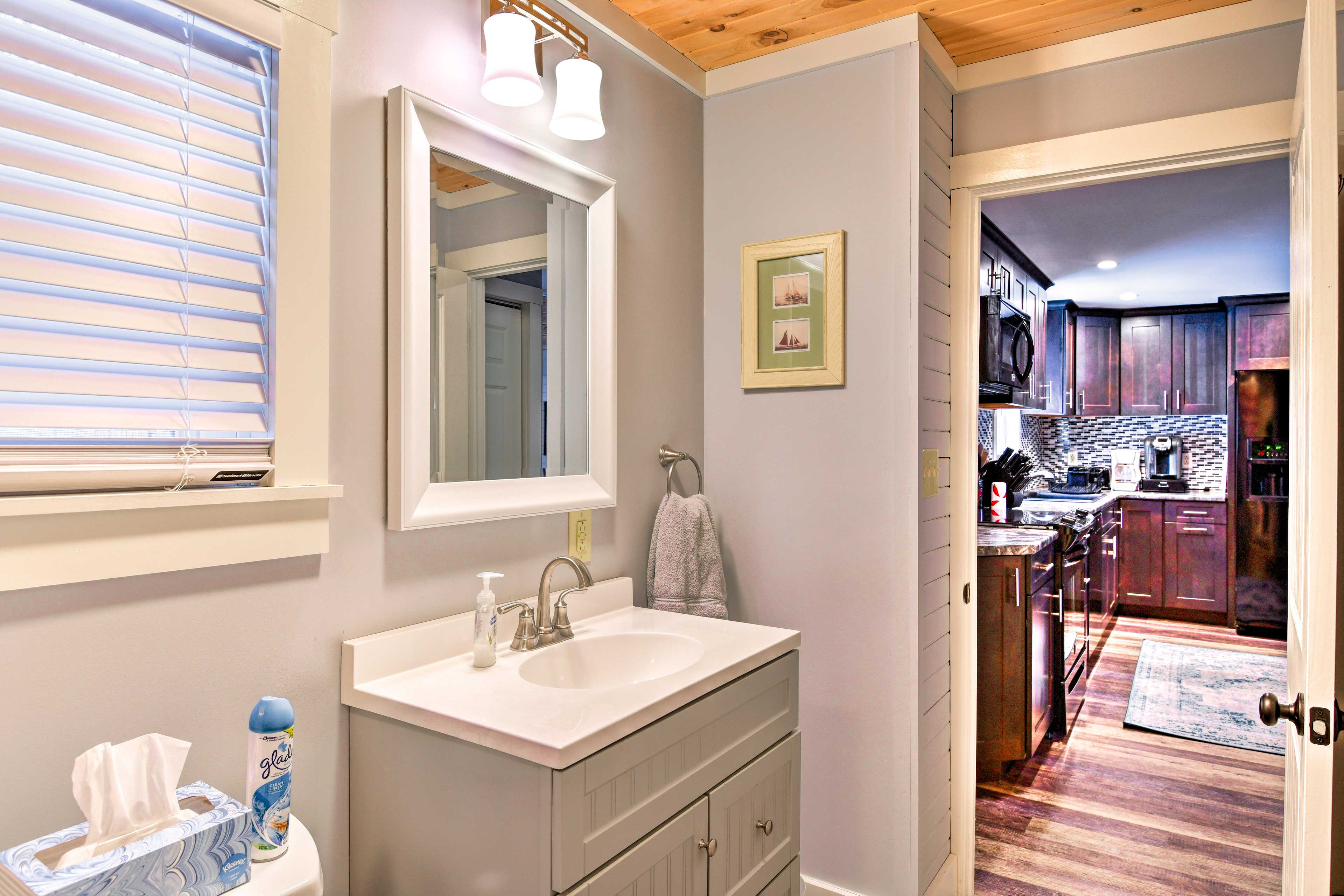 The first bathroom is located off the kitchen.