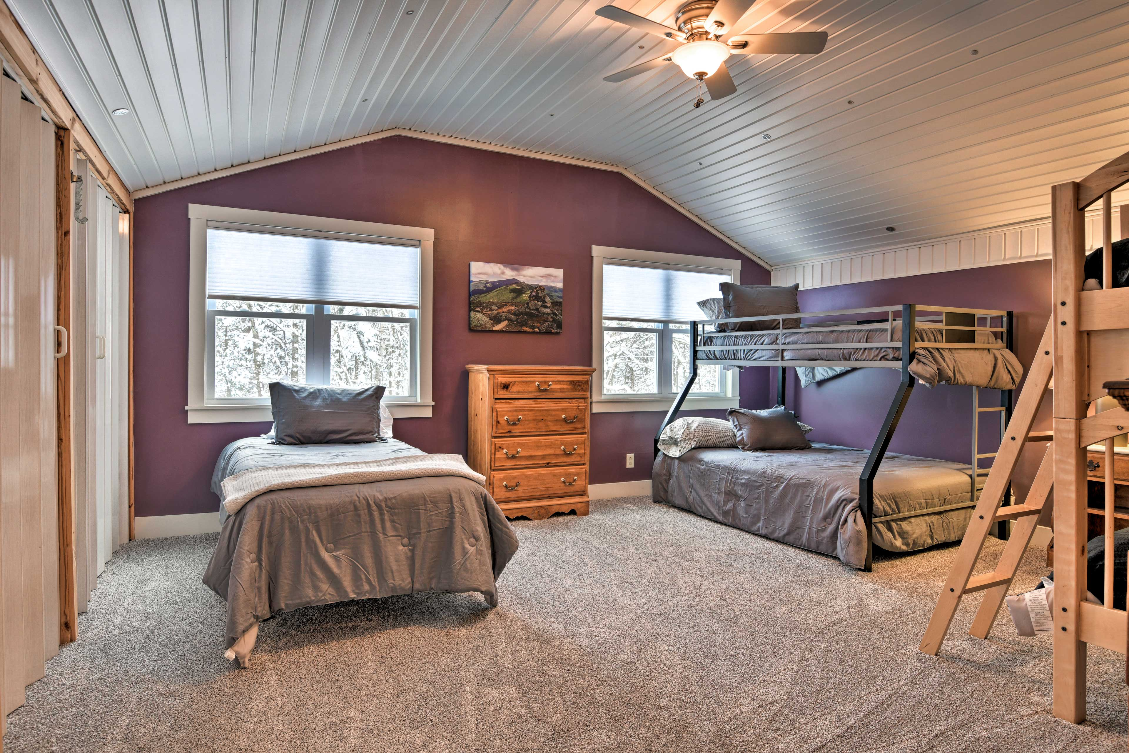 The third room has 2 sets of bunk beds and another twin bed.