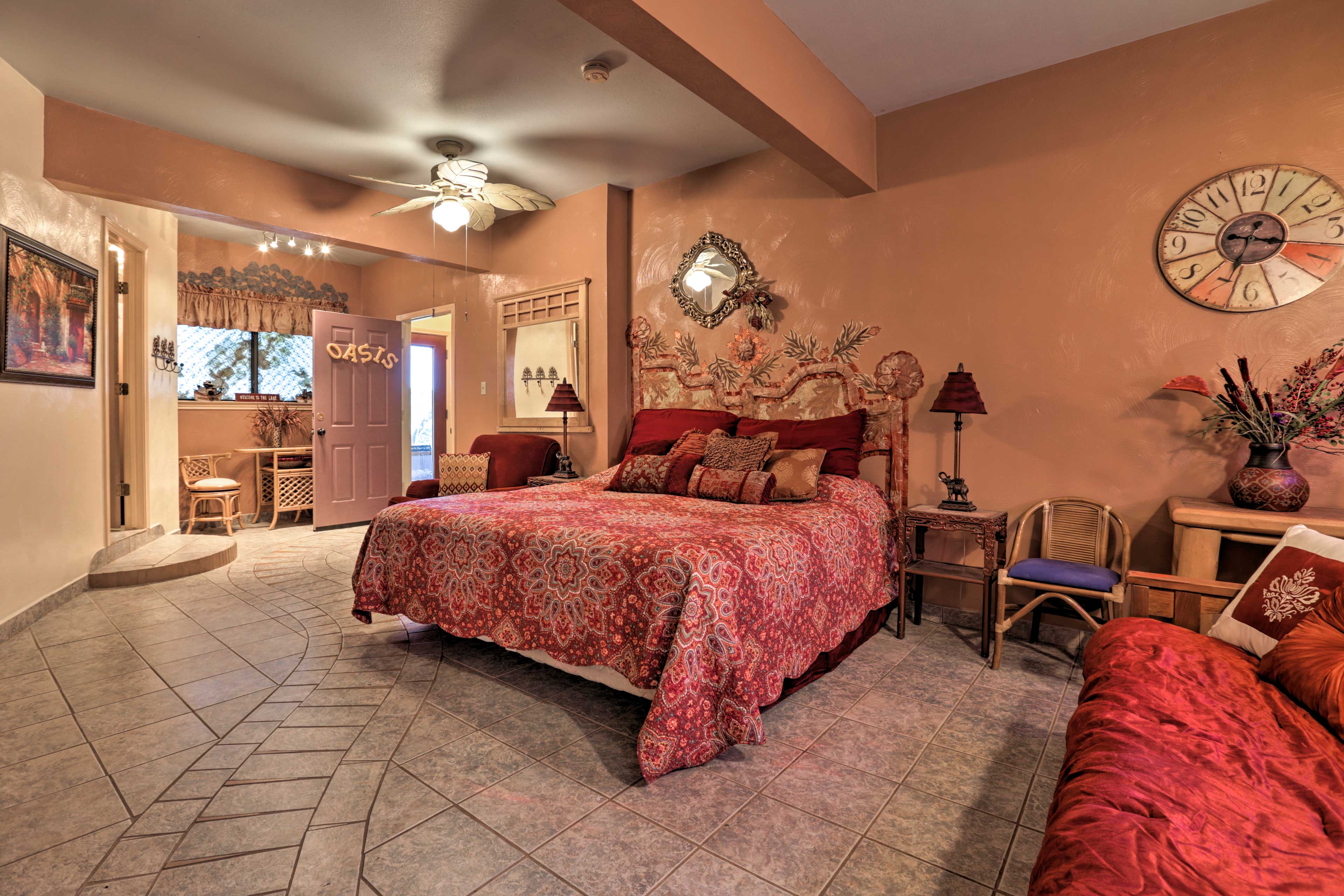 The master suite is equipped with a king bed & futon.