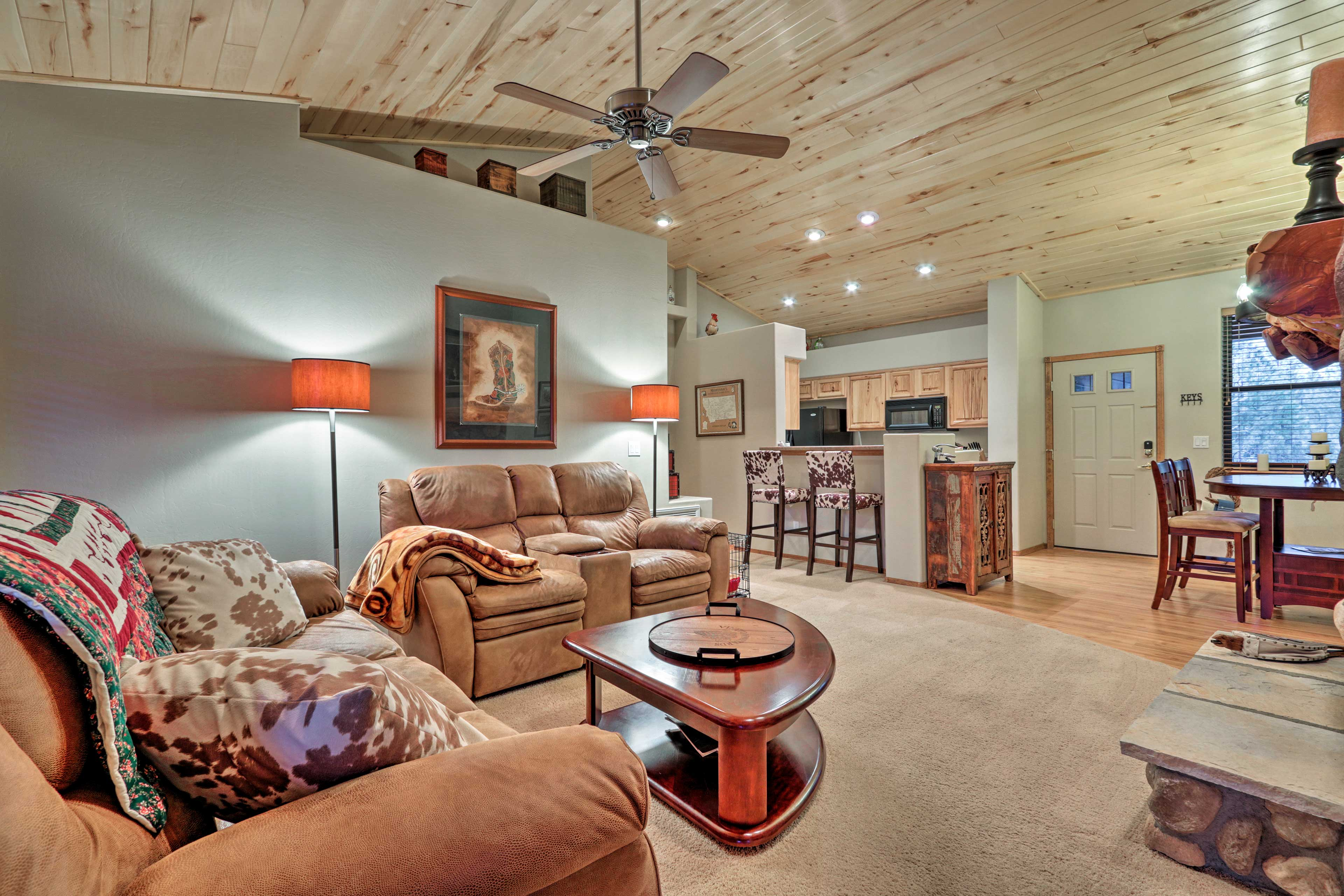 High ceilings and wood paneling accentuate the rustic appeal.