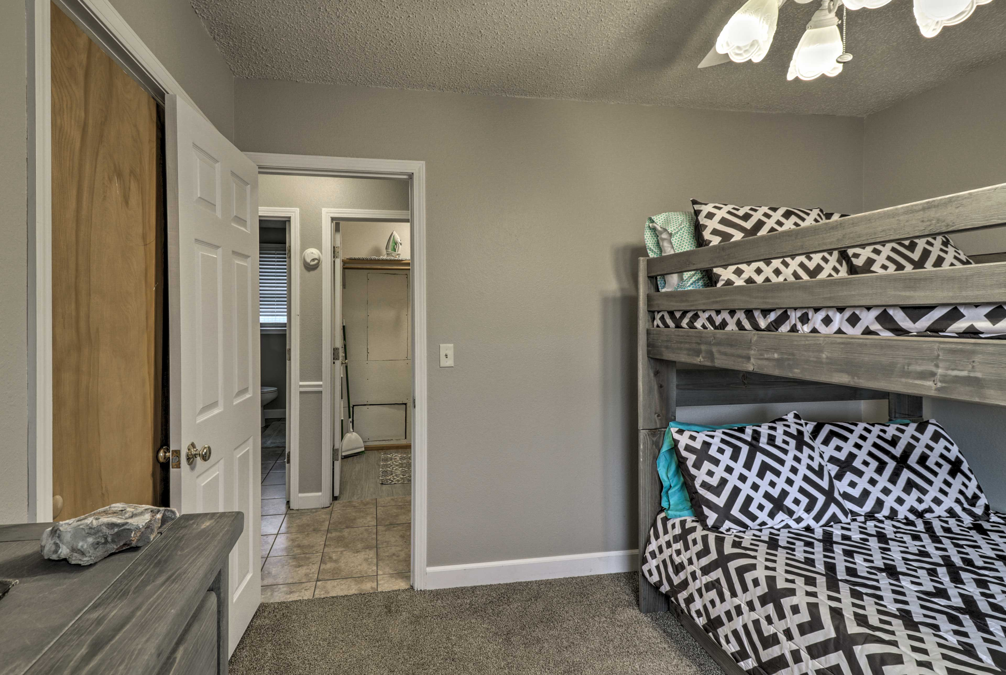 This room features a full-over-full bunk bed with a twin trundle bed.