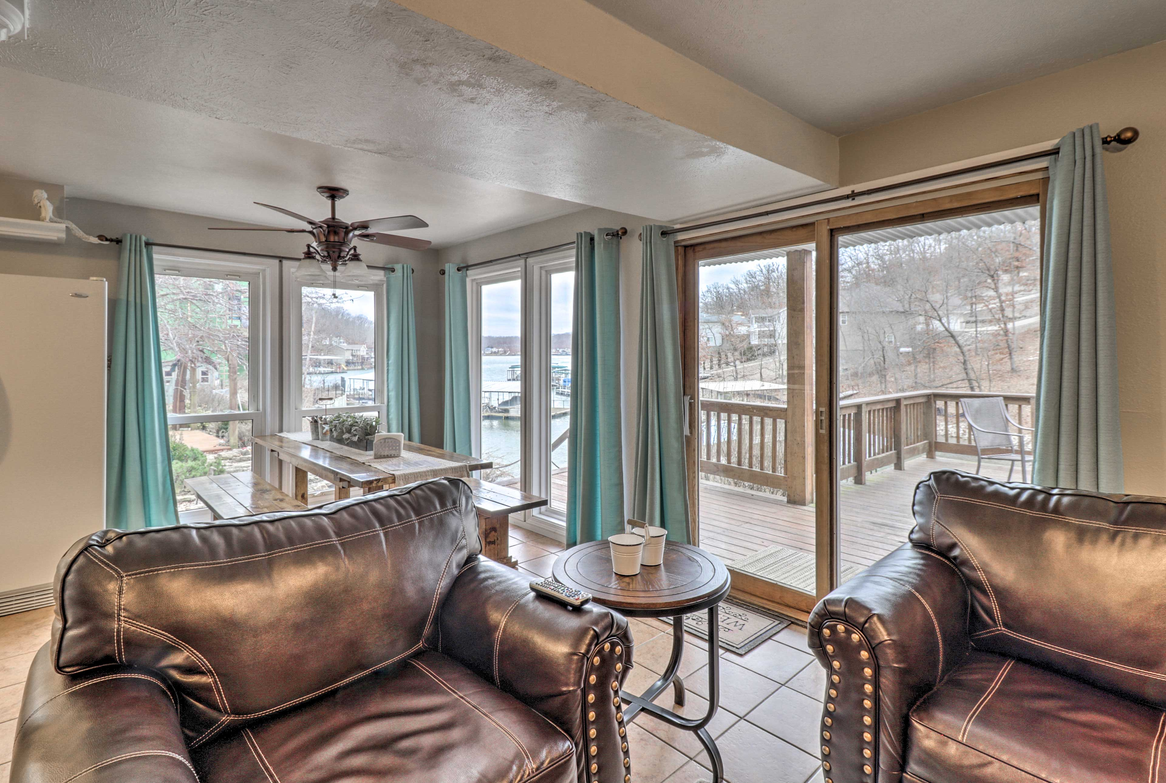 Sliding glass doors to the deck & floor-to-ceiling windows allow in ample light.