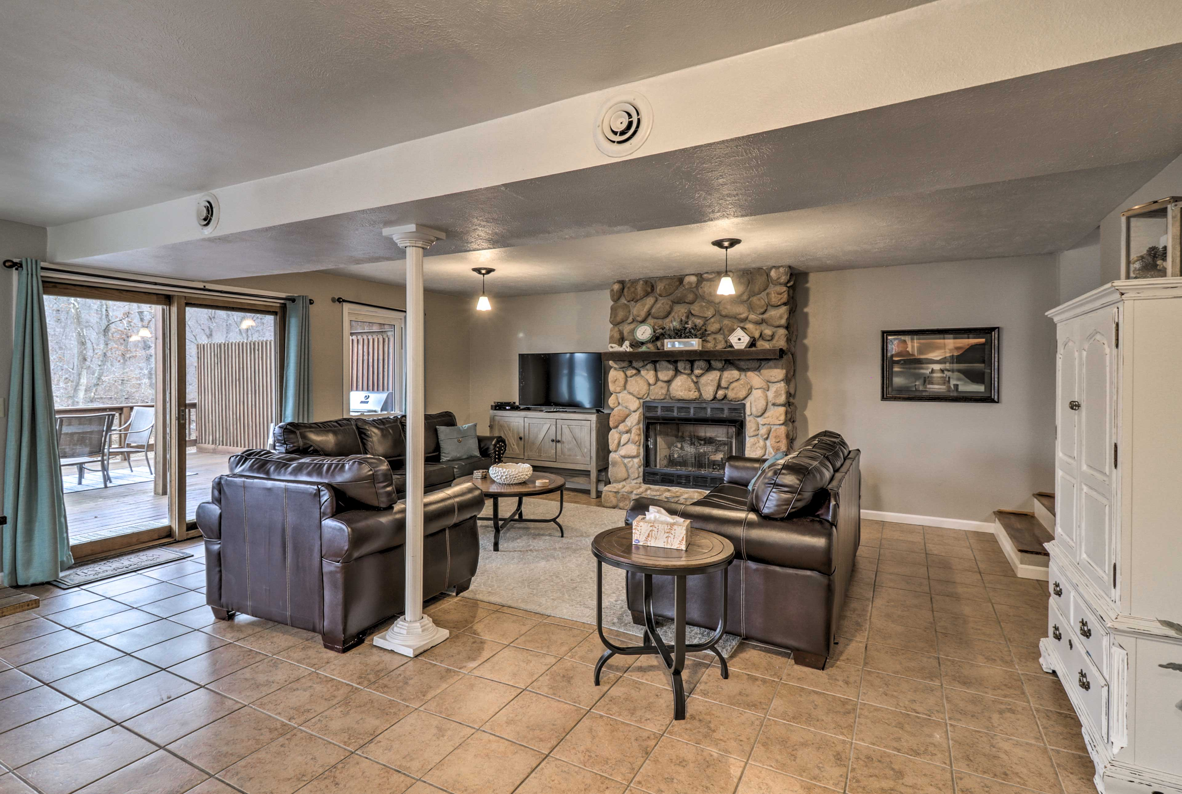 Unwind in front of the river rock fireplace & flat-screen cable Smart TV.