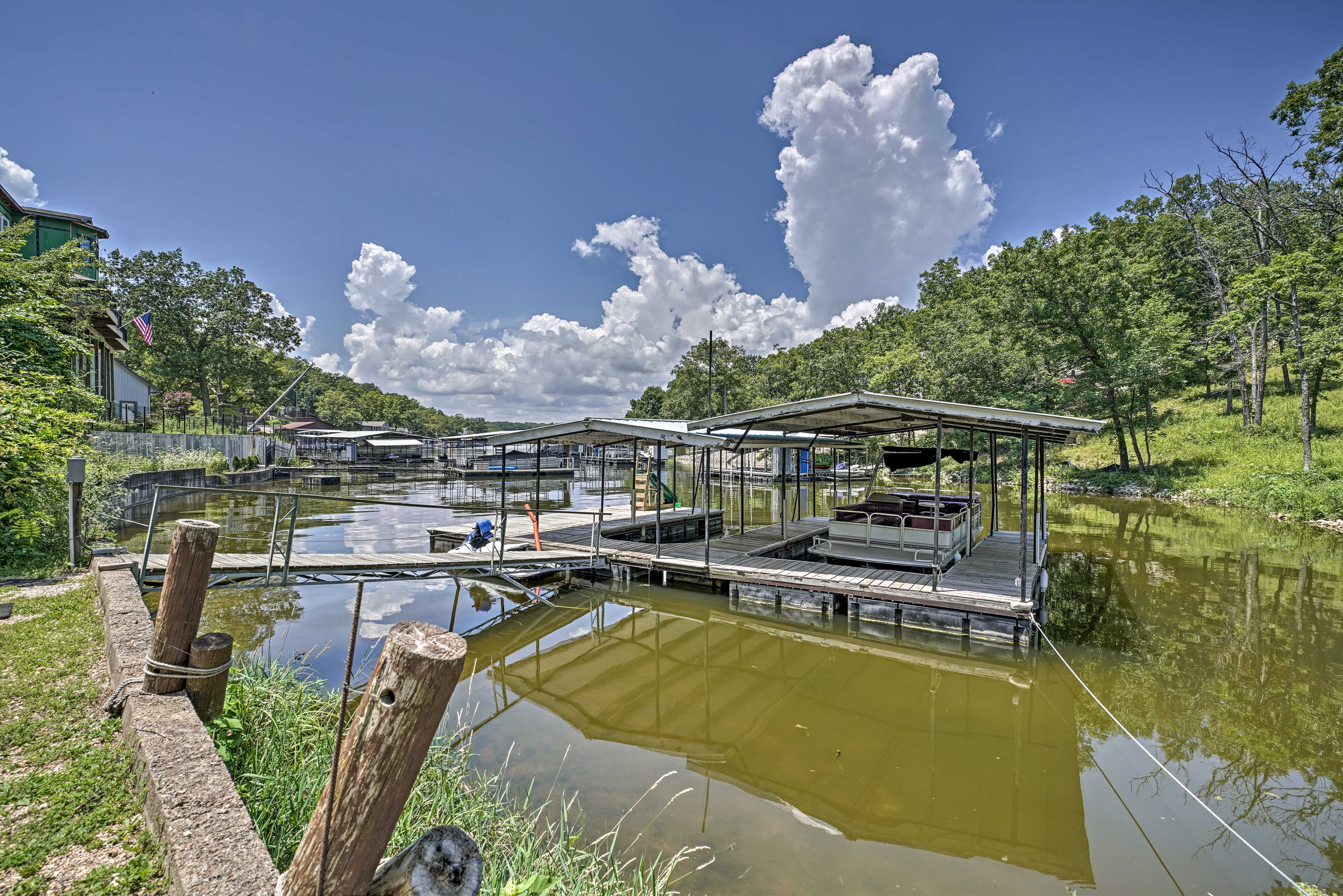 The lake house sits on Lick Branch Cove & includes a dock & swimming platform.
