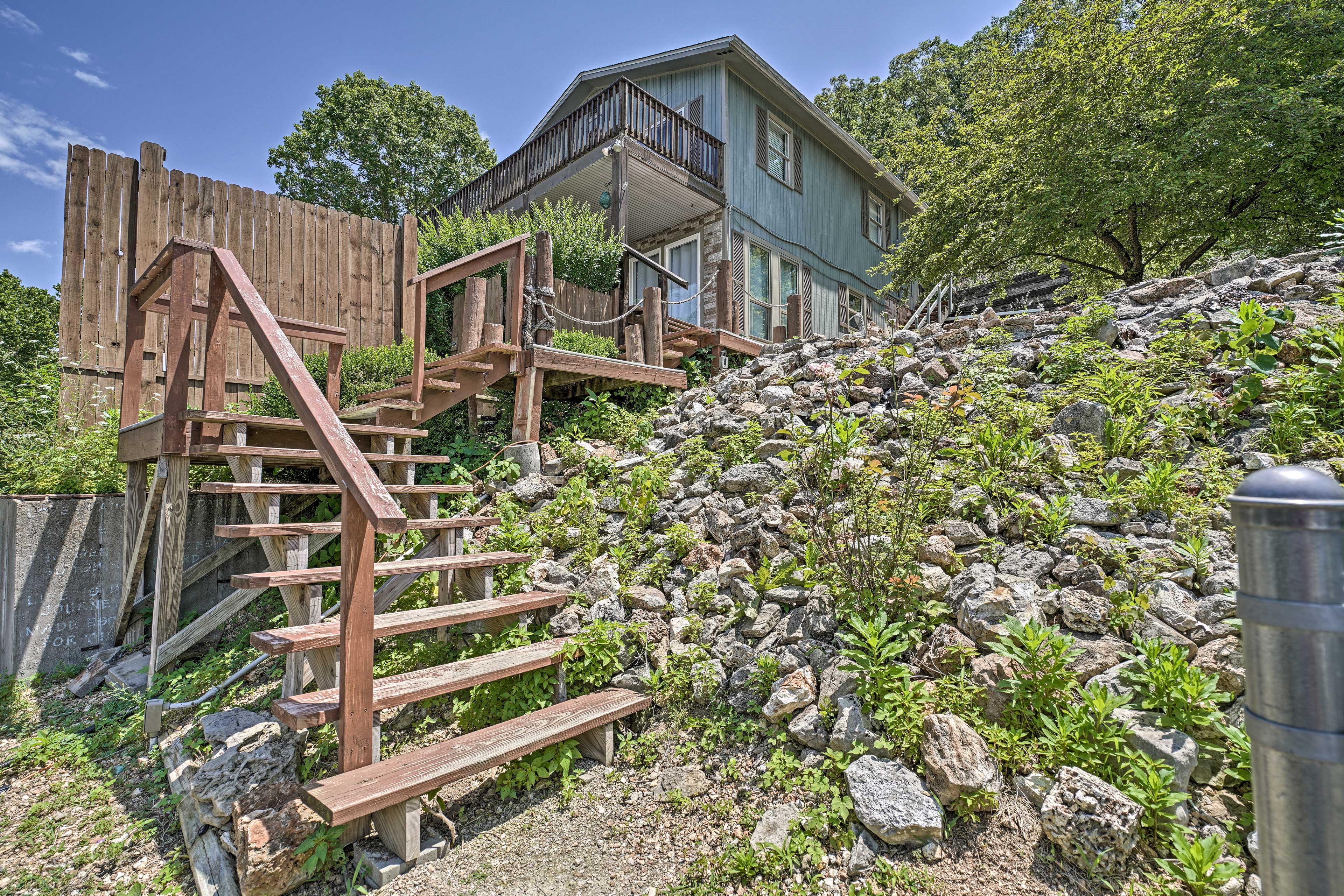 Simply walk down a flight of stairs to reach the dock & swimming platform!