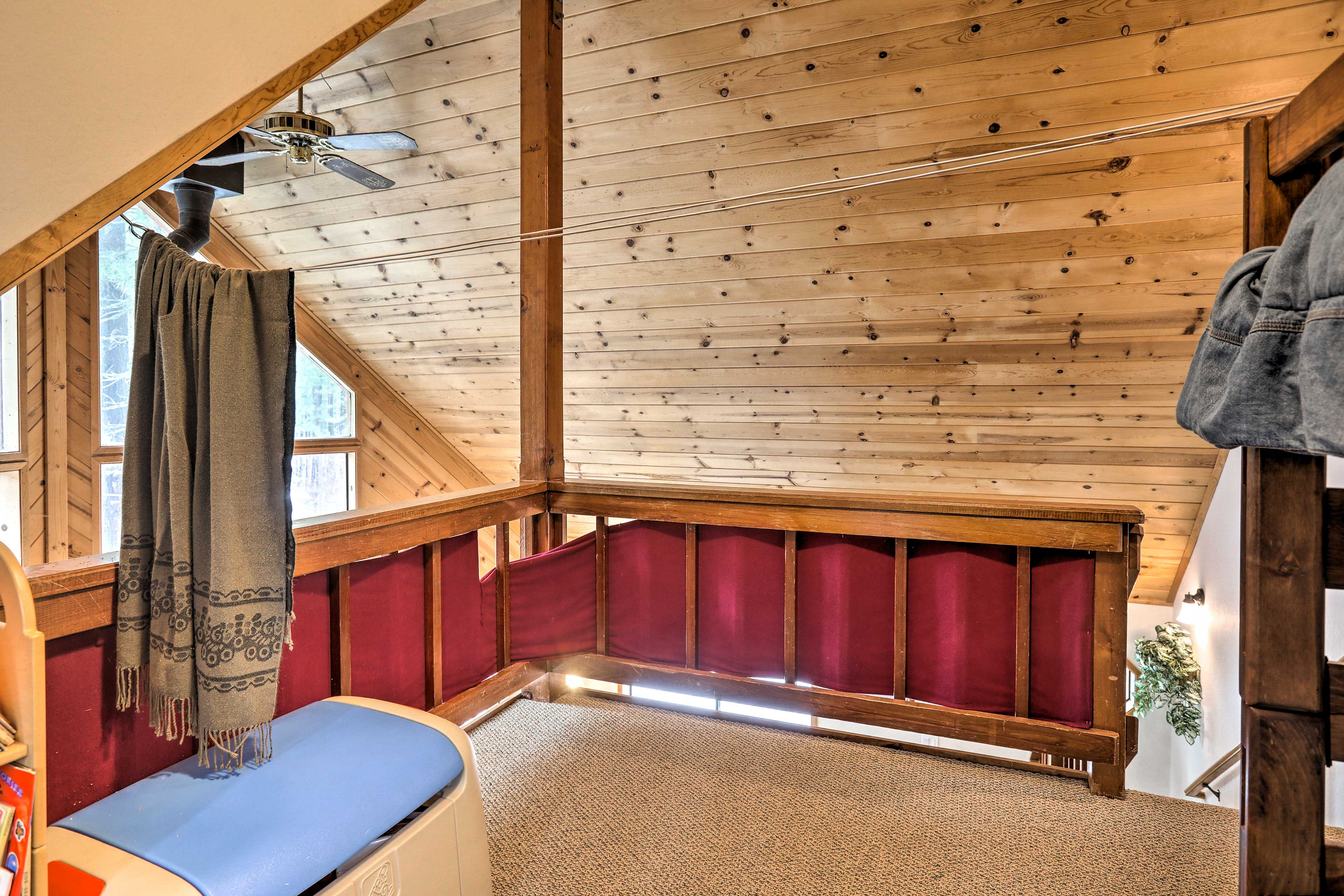 Sleek tongue & groove slanted ceilings open up the cabin.