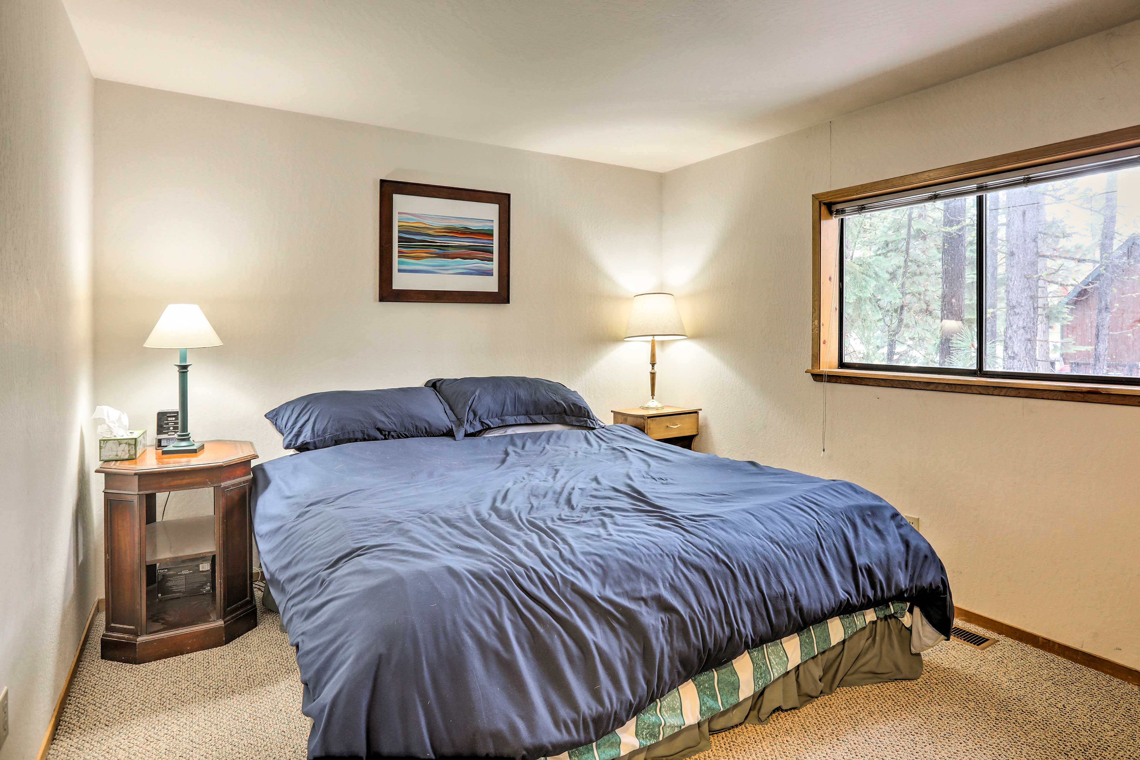 Peaceful slumbers await 2 guests in the light & airy third bedroom.