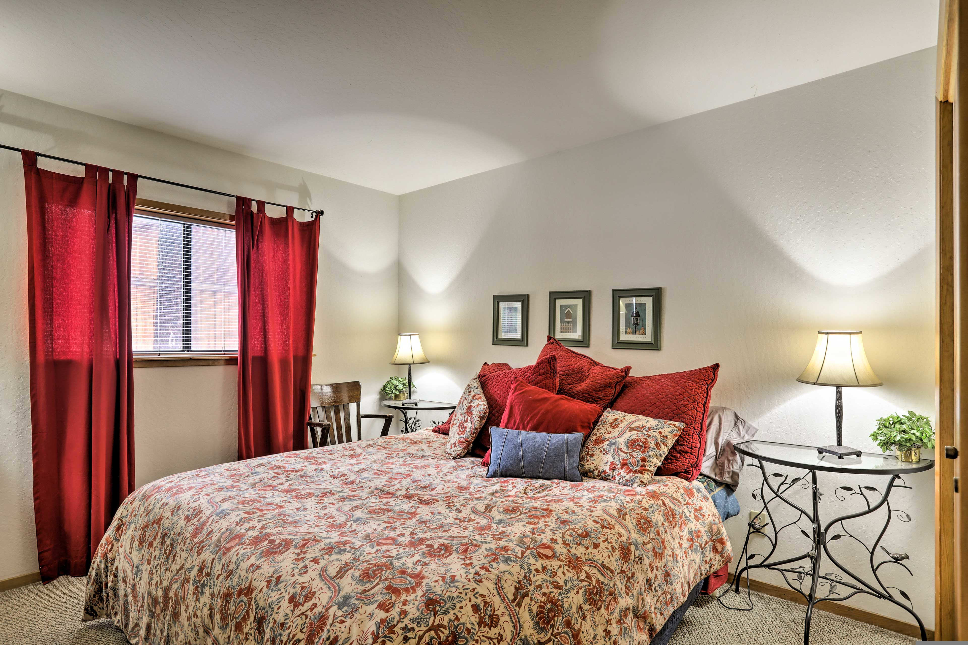 The first bedroom features a beautiful California King bed.