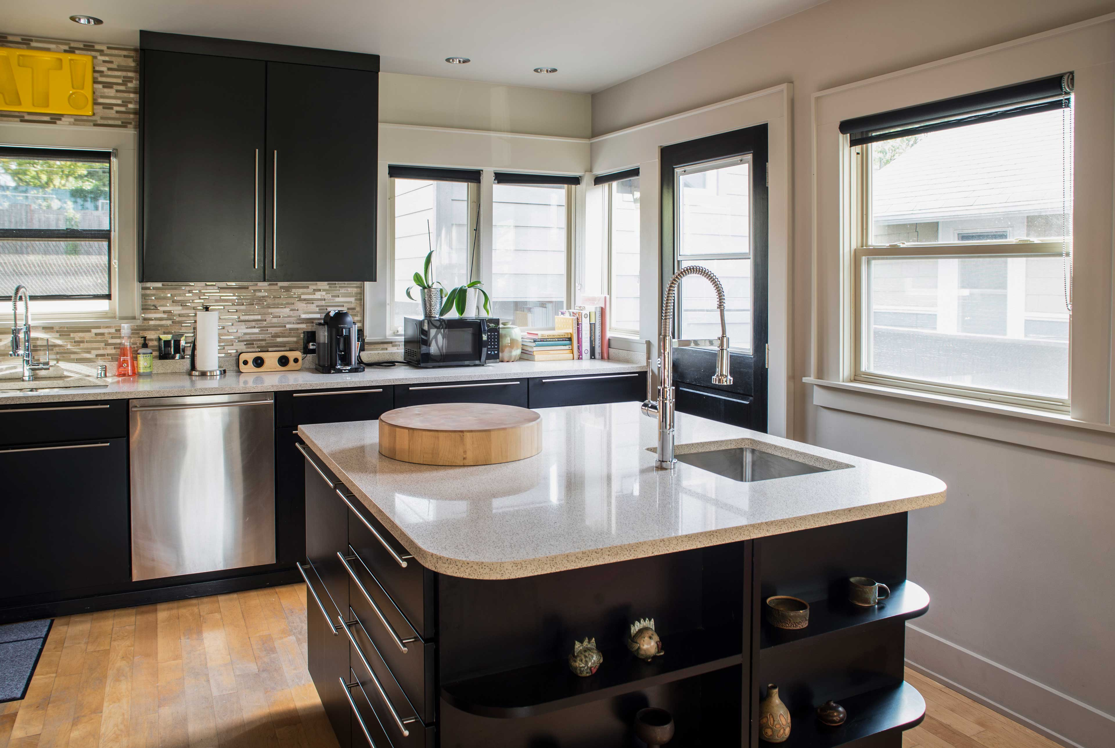 The kitchen comes fully equipped with stainless steel appliances.