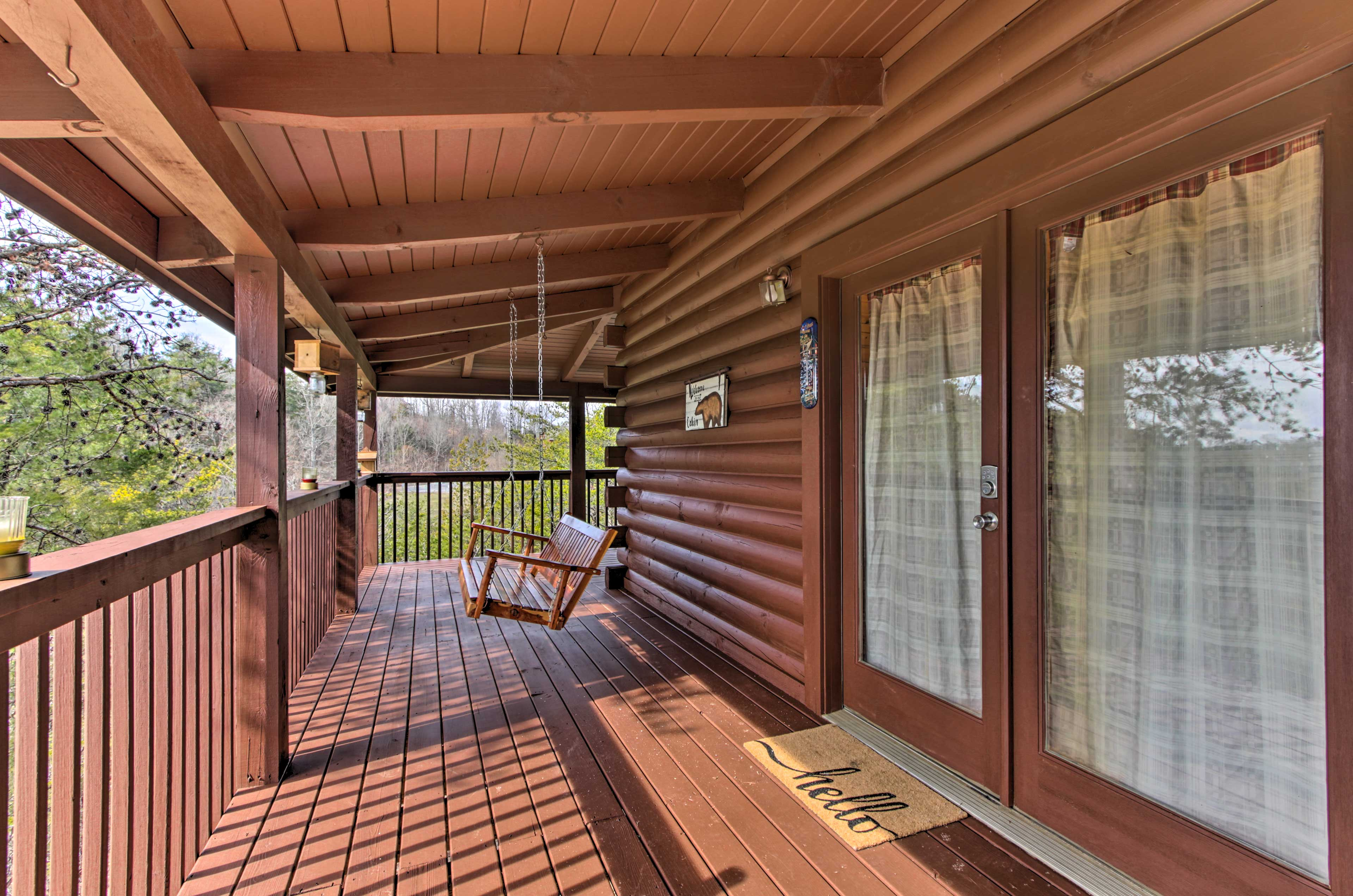 The front porch features a swing perfect for lazy afternoons.