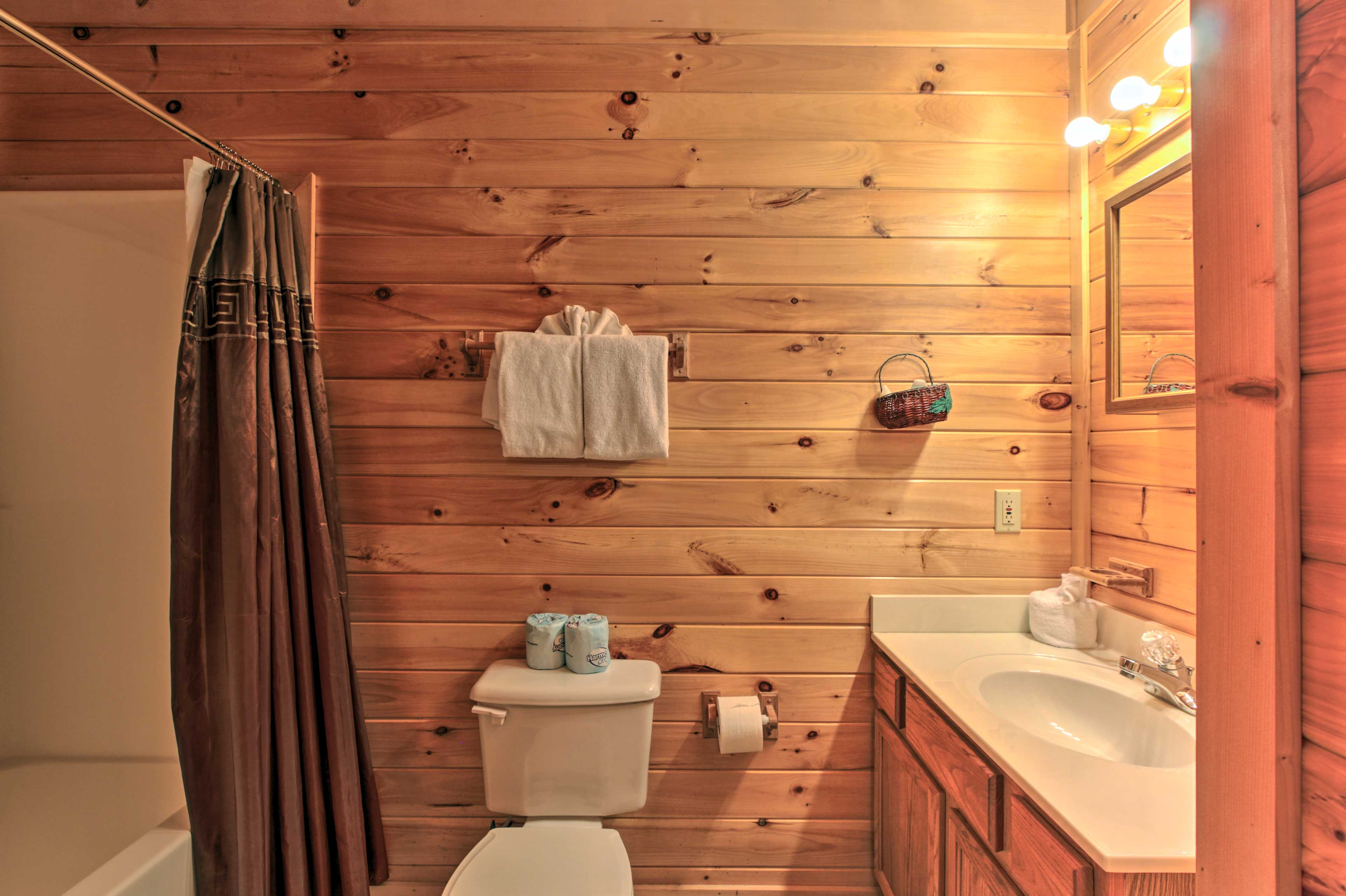 The en-suite bathroom has a shower/tub combo and room for your toiletries.