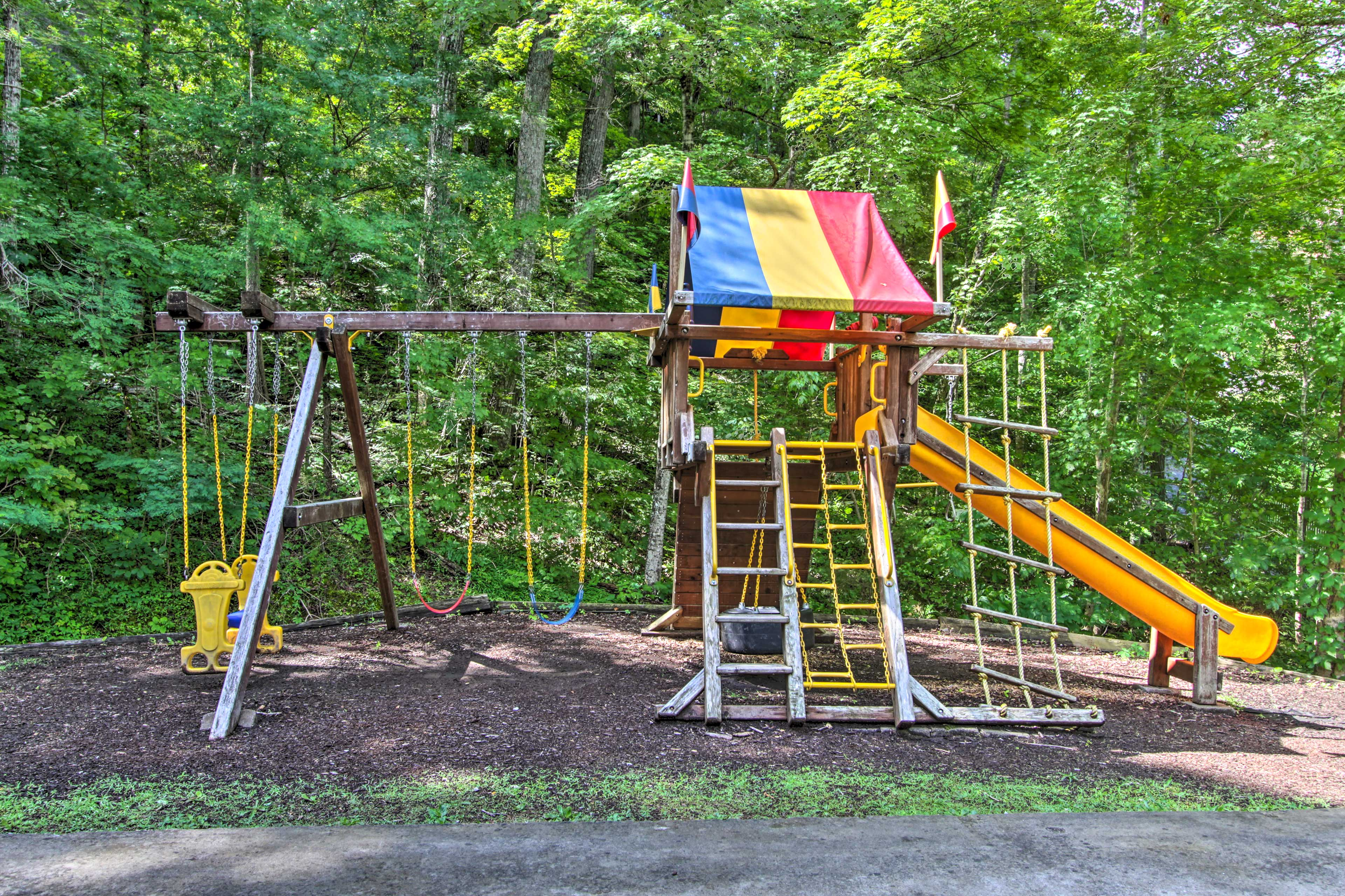 Kids will love playing on the swing set.