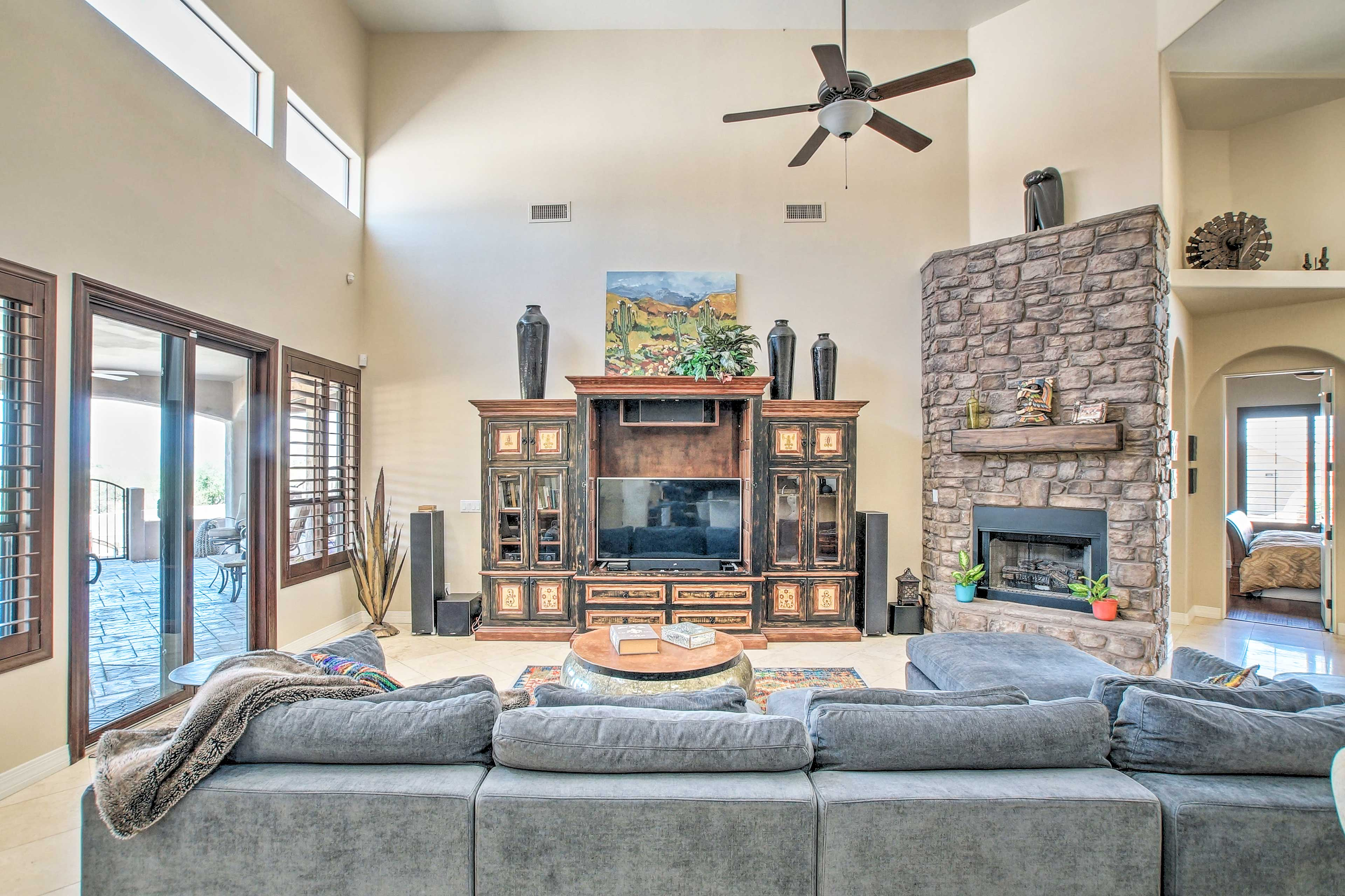 The many windows and high ceilings provide plenty of natural light.