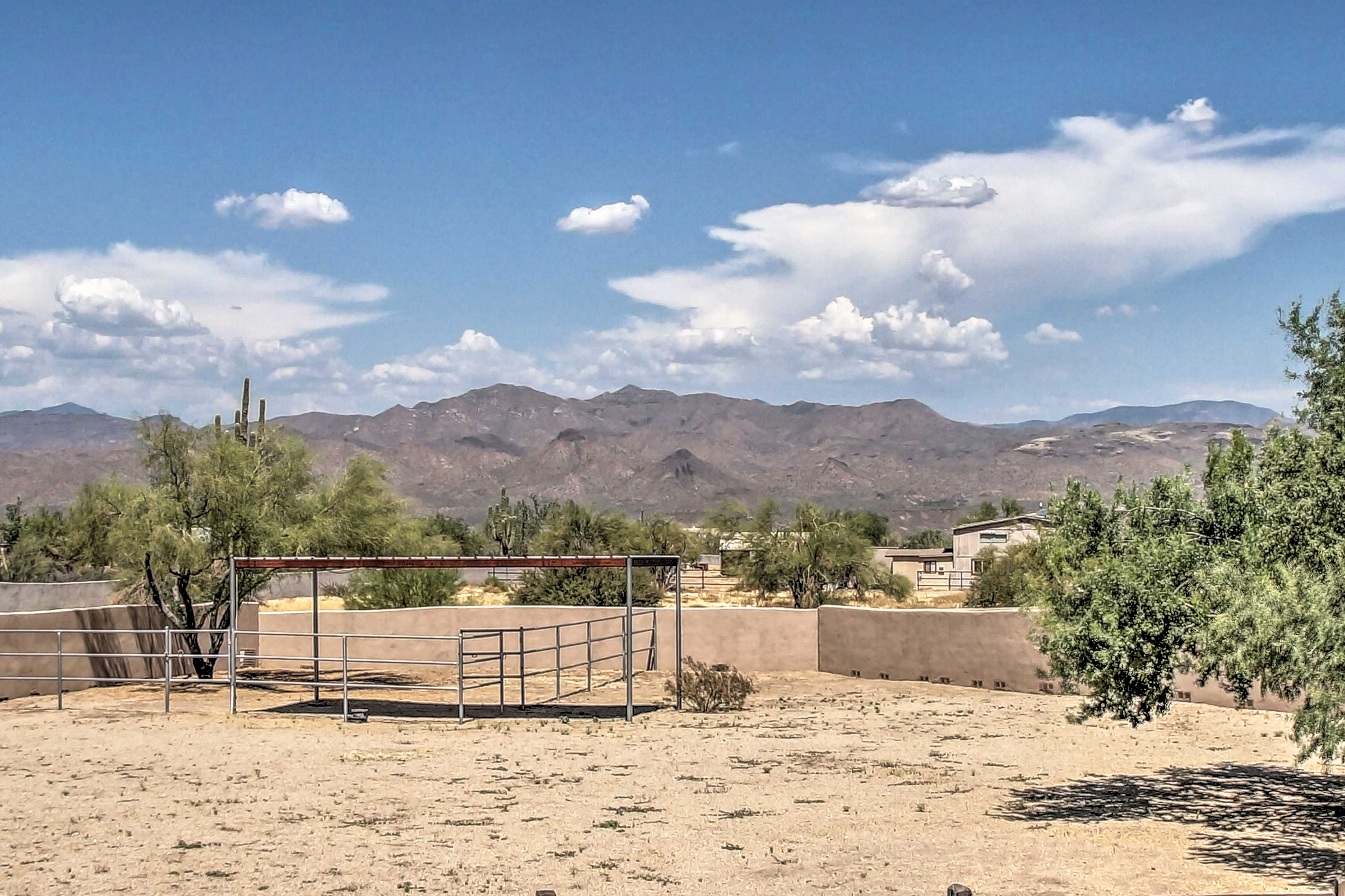 The large private yard features these stunning mountain views!