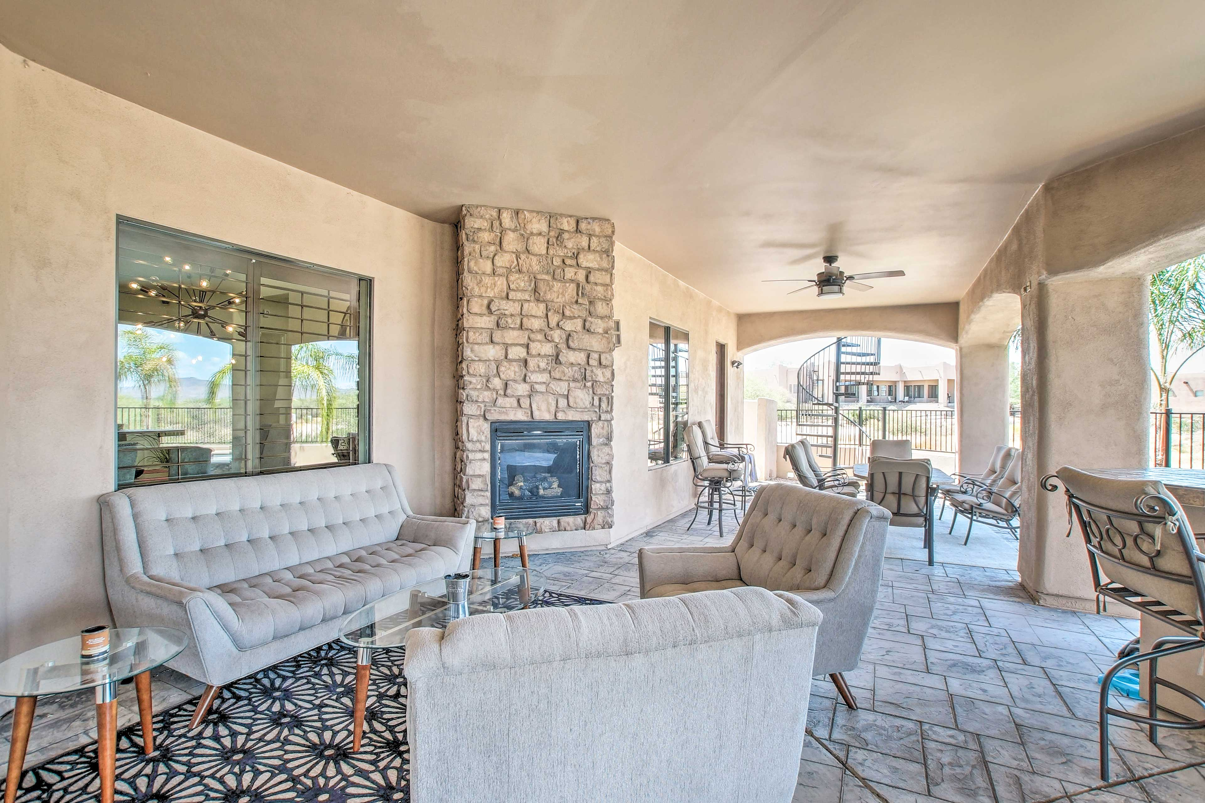 There's ample seating around the outdoor fireplace.