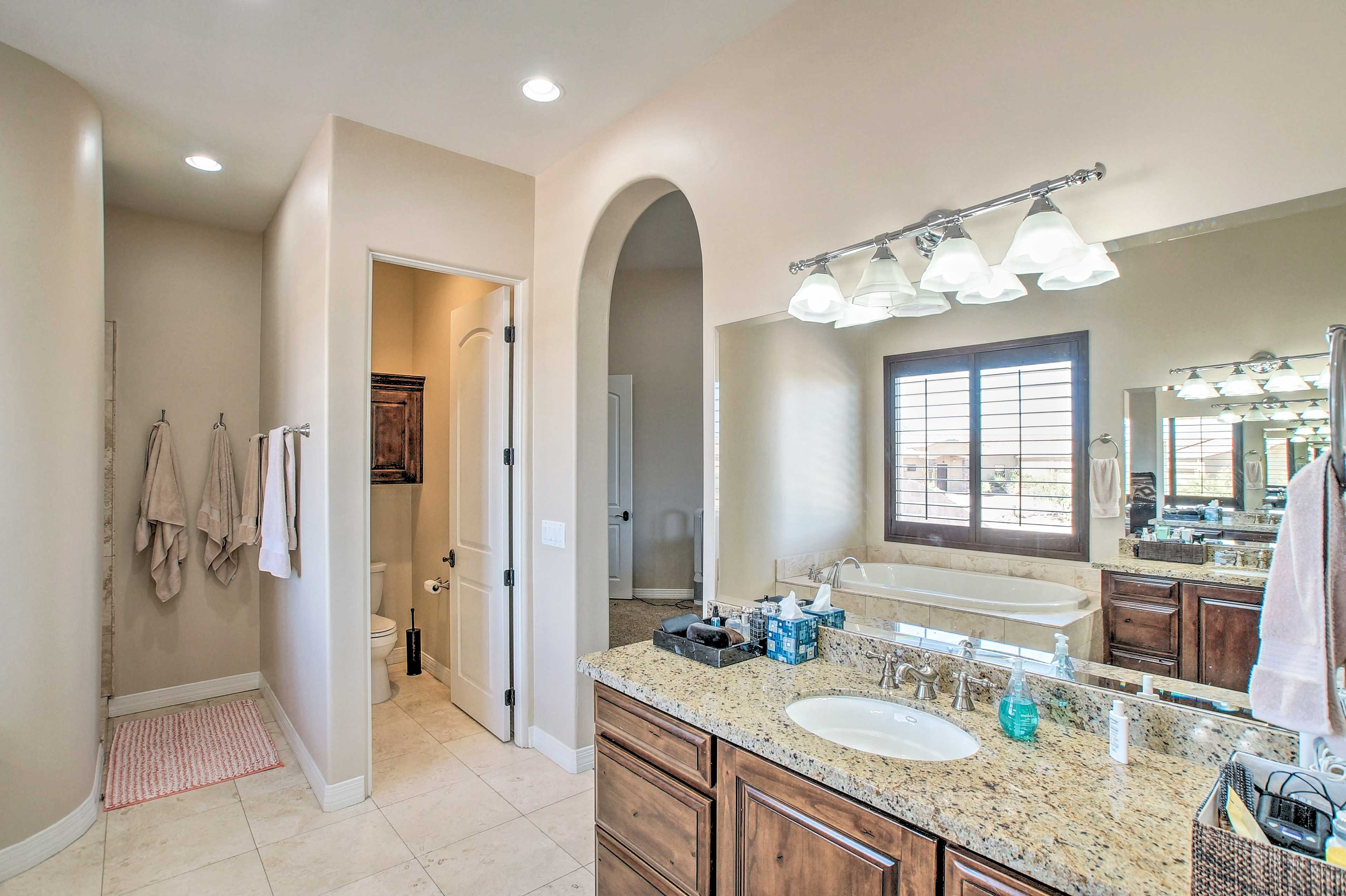Getting ready will be easy in the spacious bathroom.