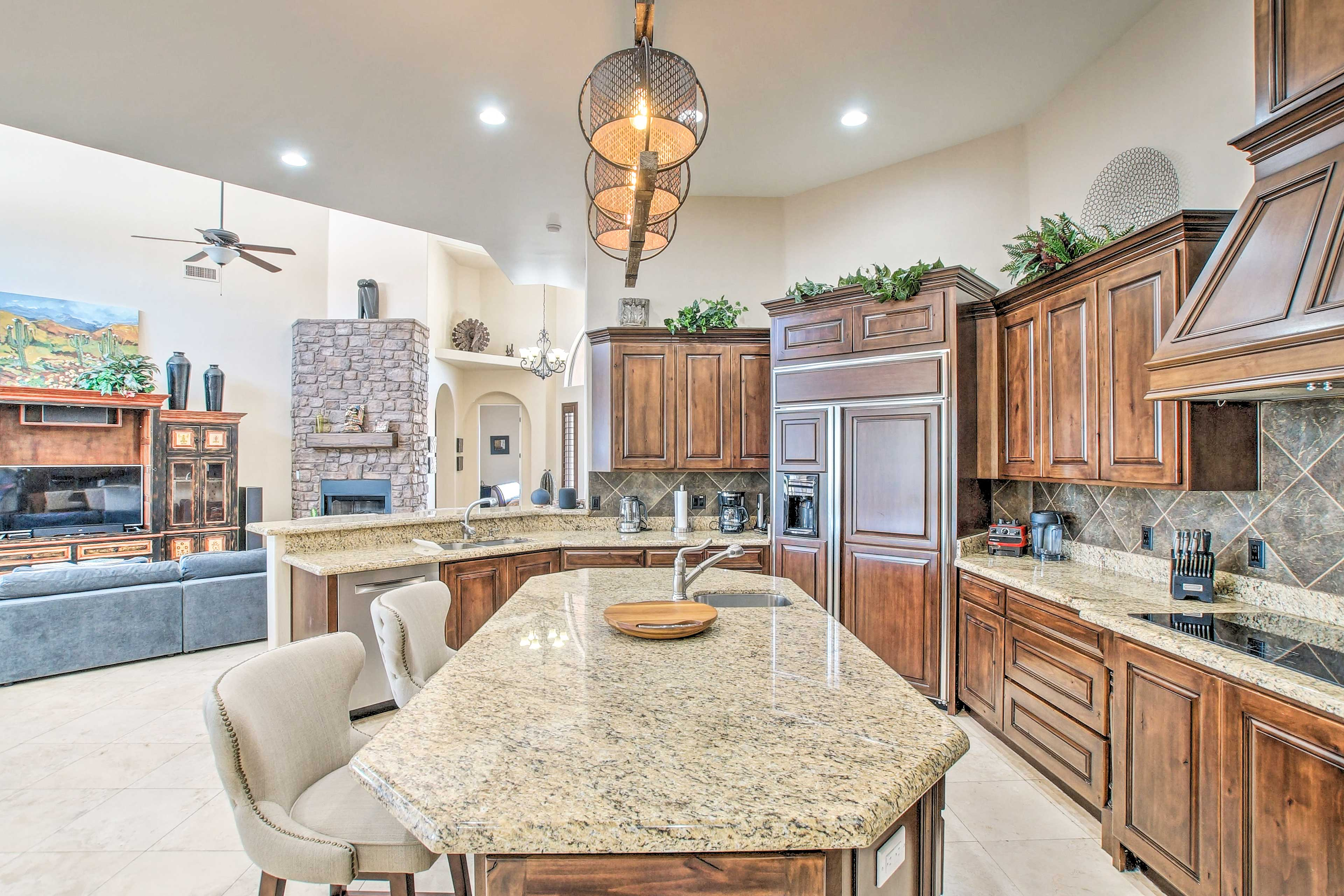 The fully equipped kitchen with granite countertops makes cooking a breeze.