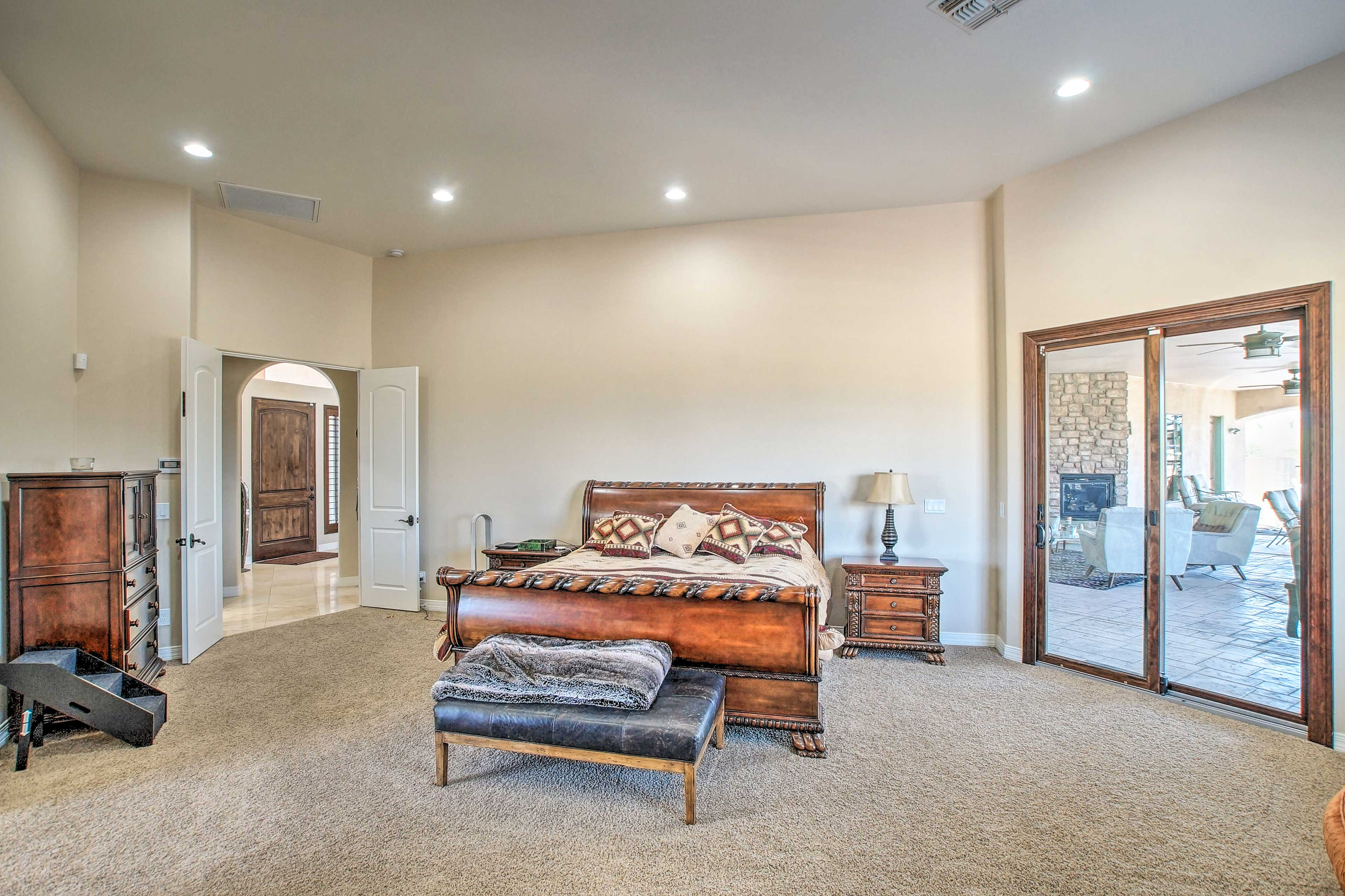 The master bedroom boasts a king bed, patio access, and an en-suite bathroom.