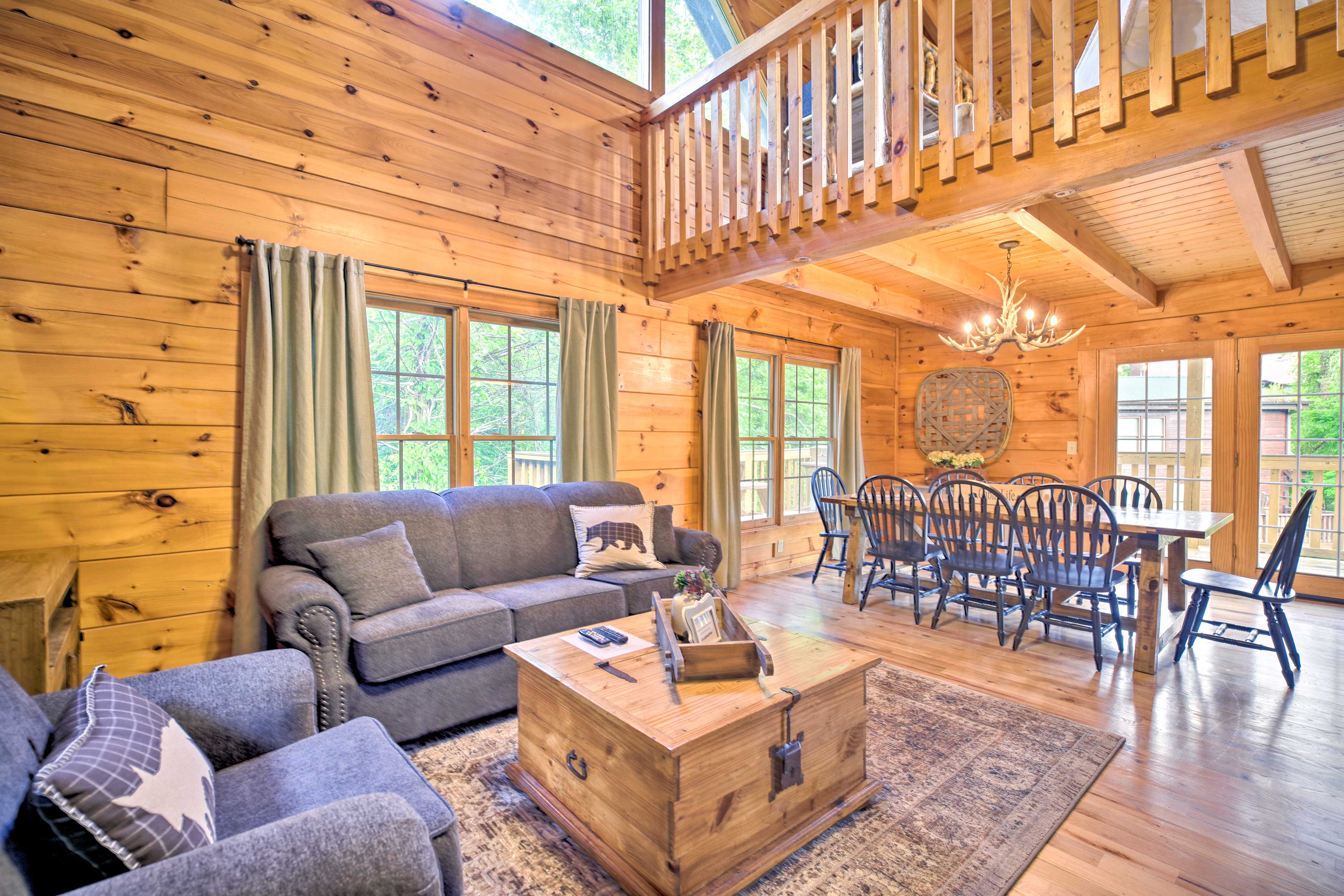 Knotty pine wood walls and vaulted ceilings complete the space.