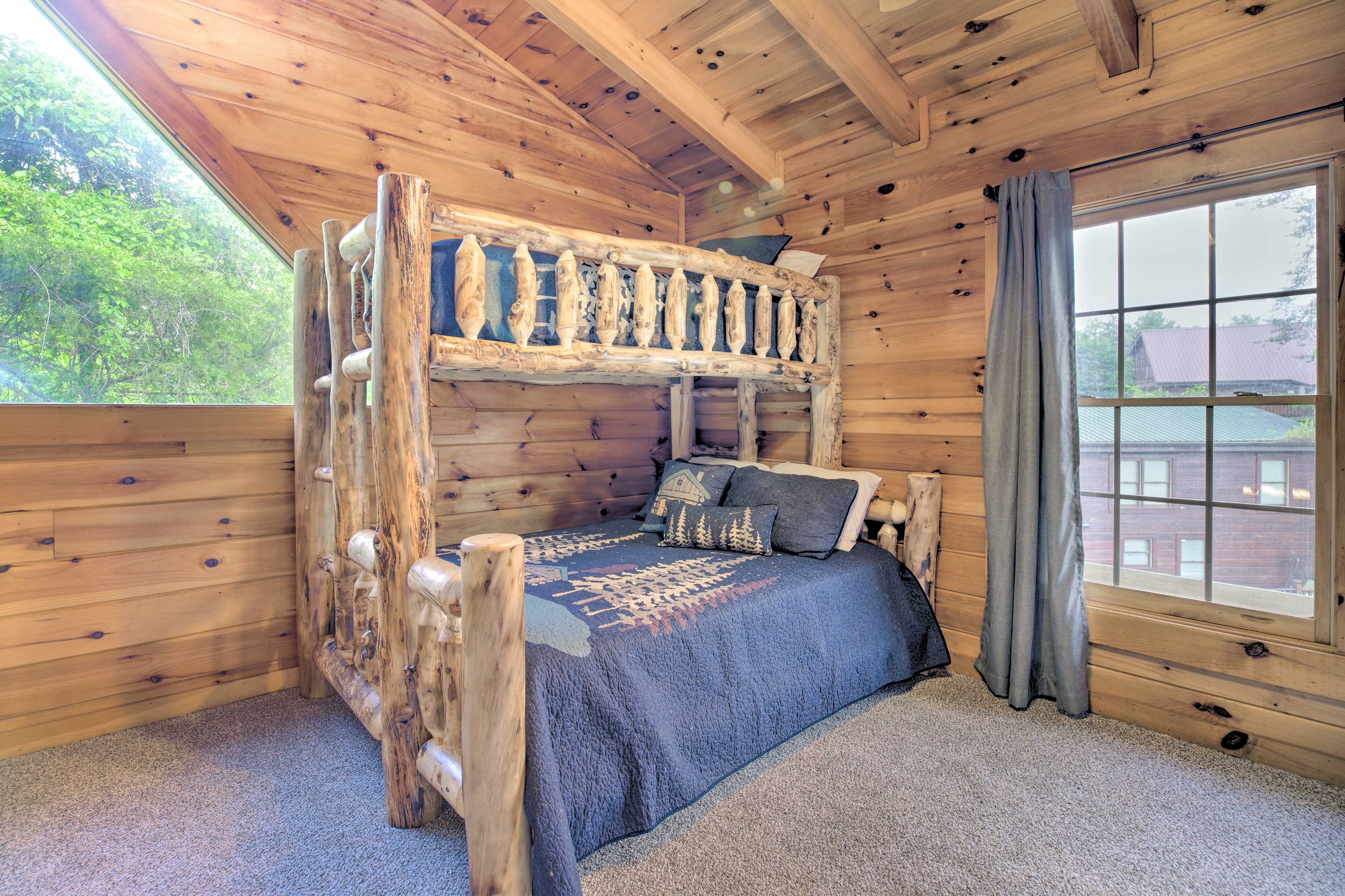 The loft features a twin-over-queen bunk bed.