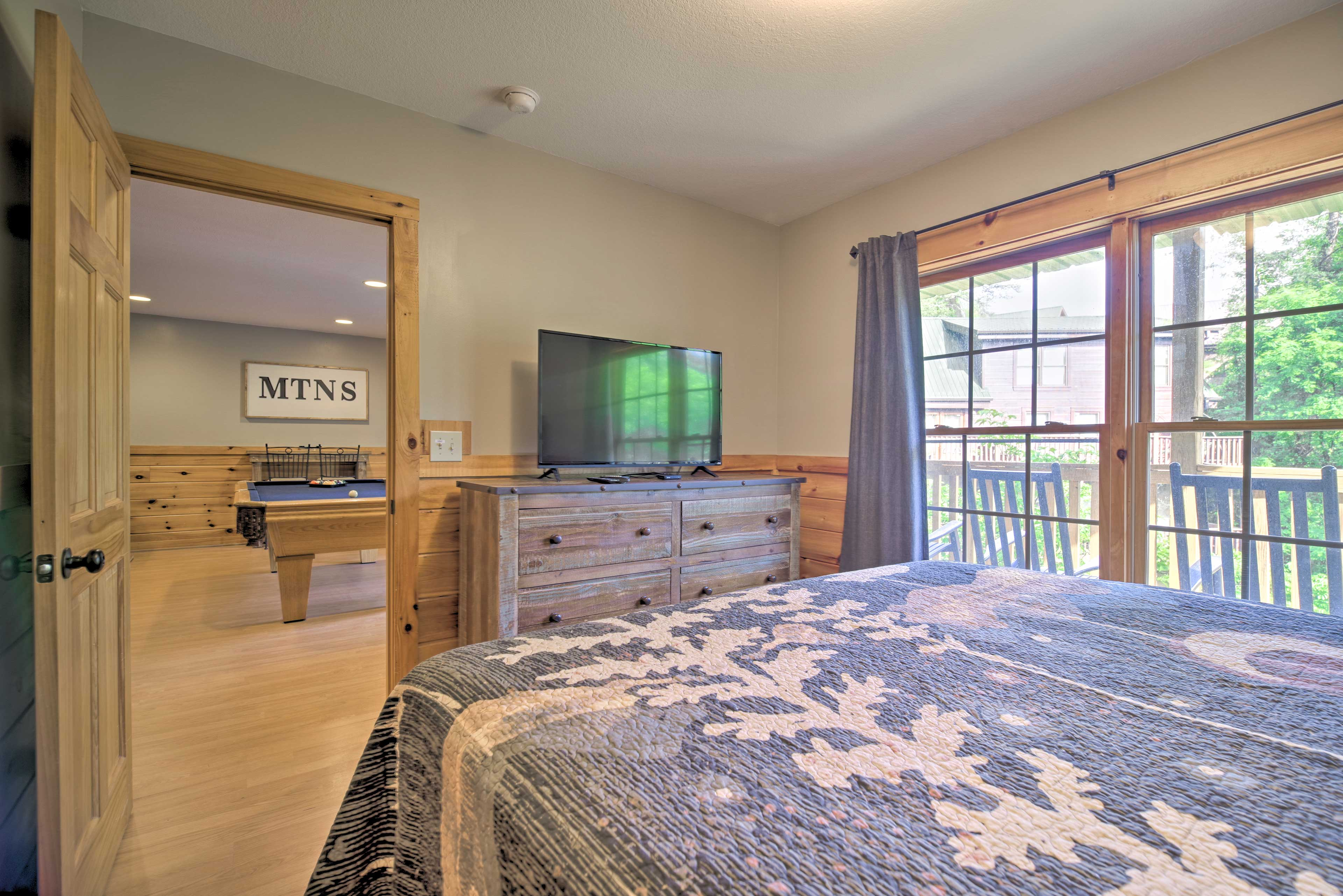 This room features a king-sized bed and flat-screen TV.