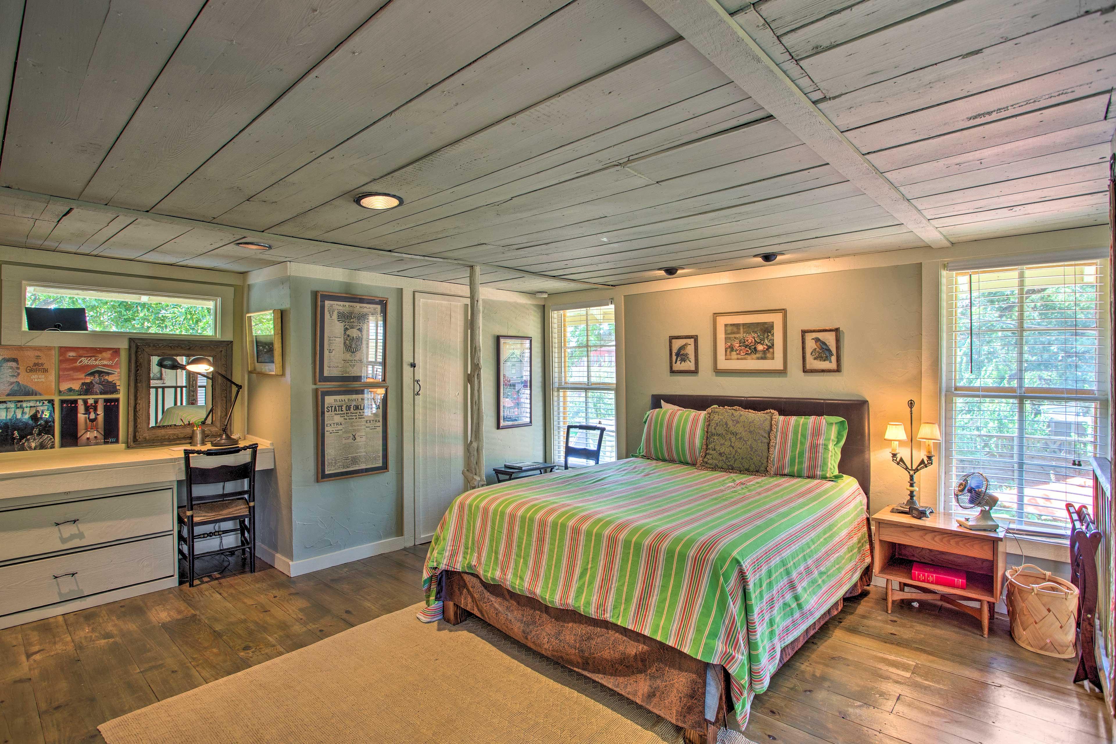 Upstairs, the bedroom features hardwood floors.