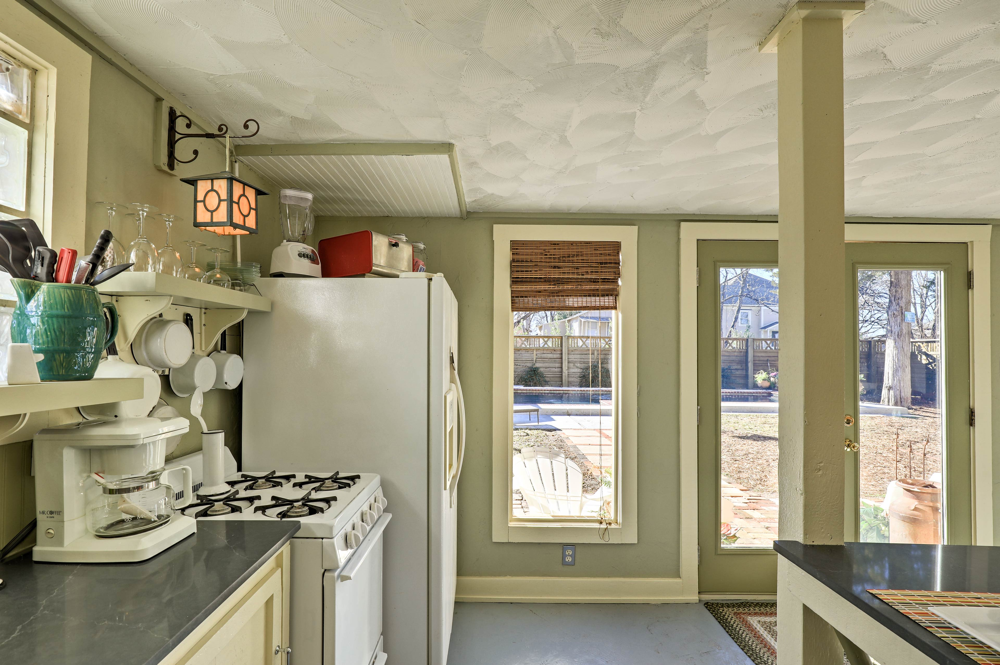 This quirky kitchen boasts open shelving.