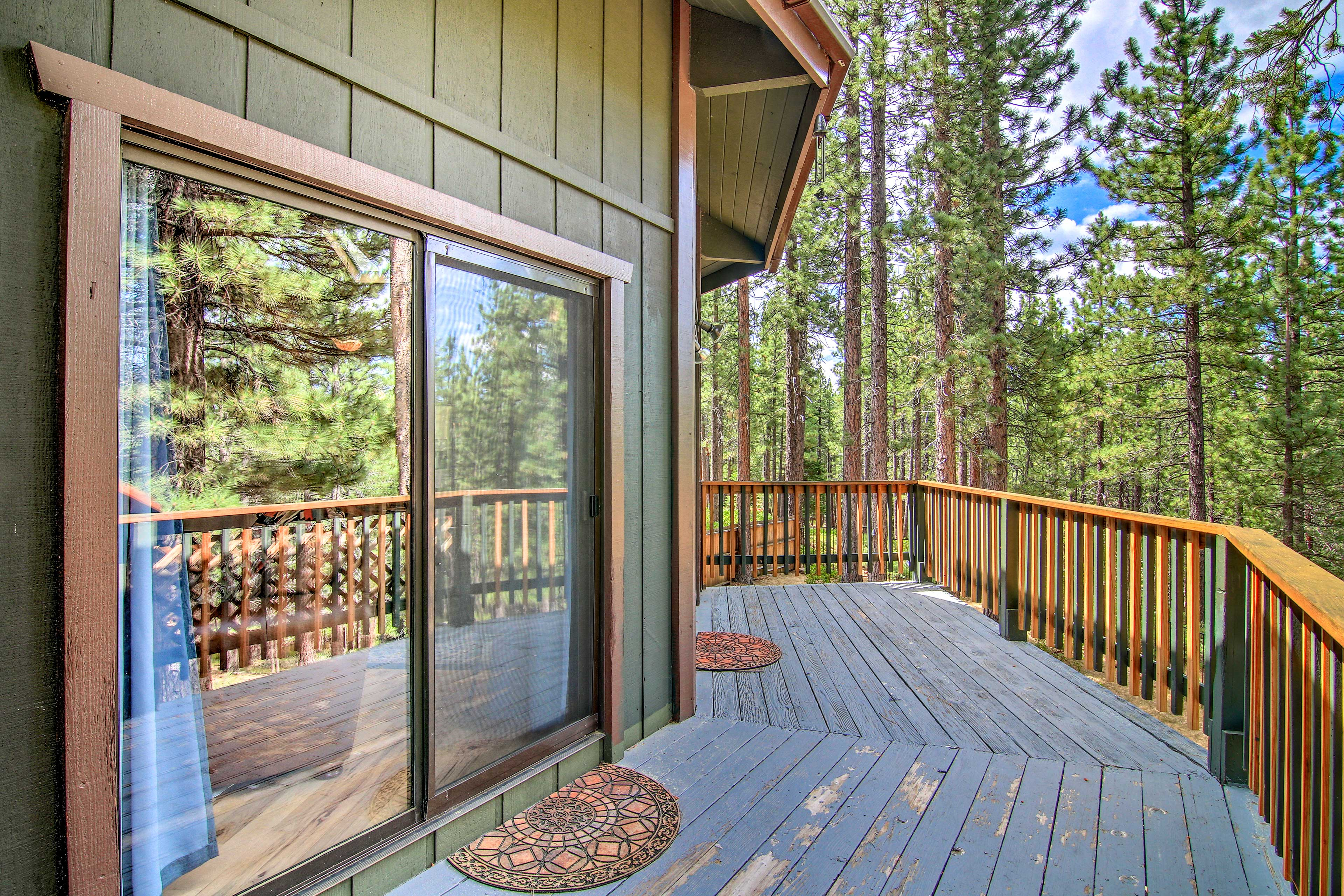 Enjoy forested views from the deck.