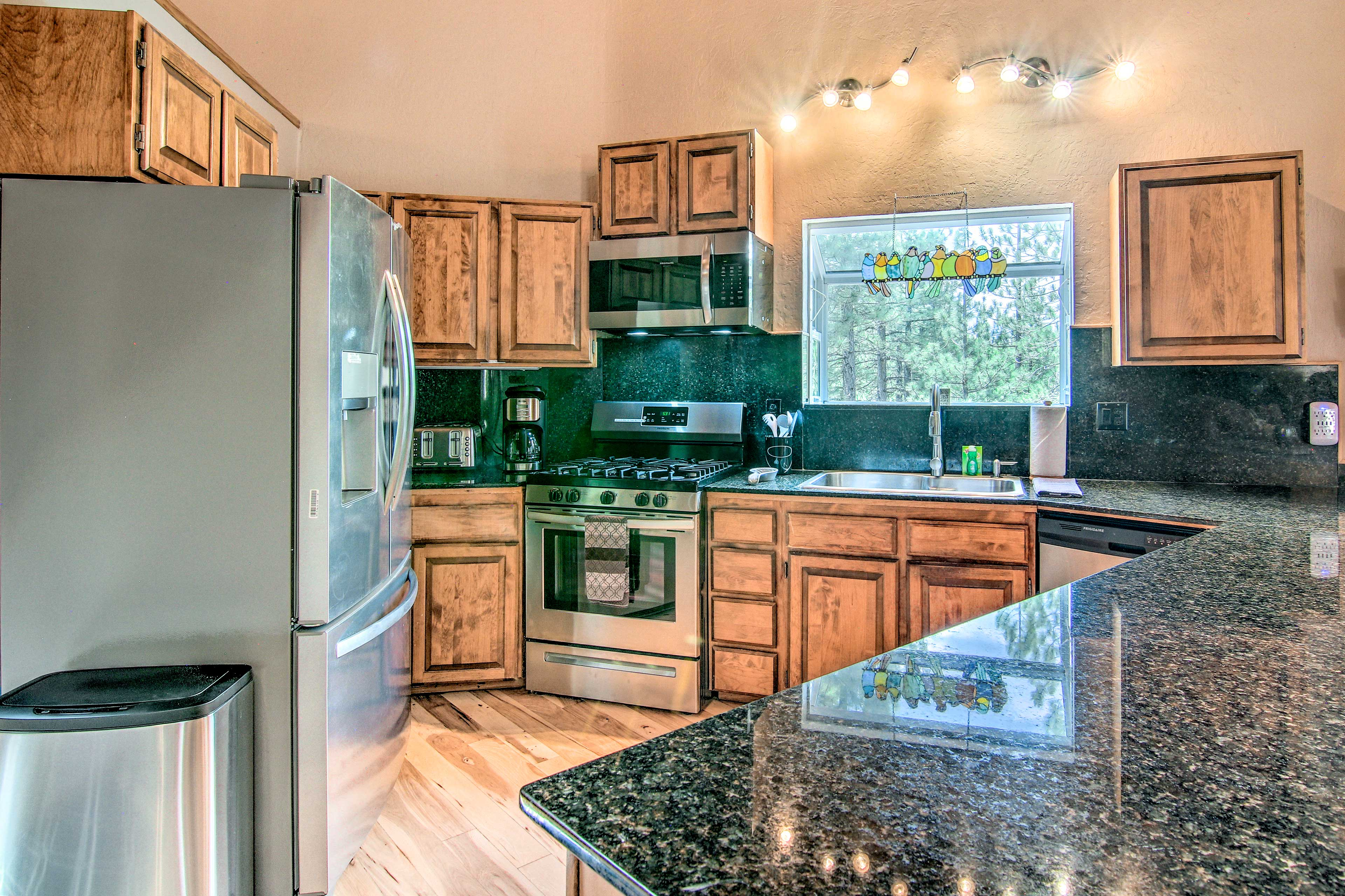 Get cooking in the kitchen complete with stainless steel appliances.