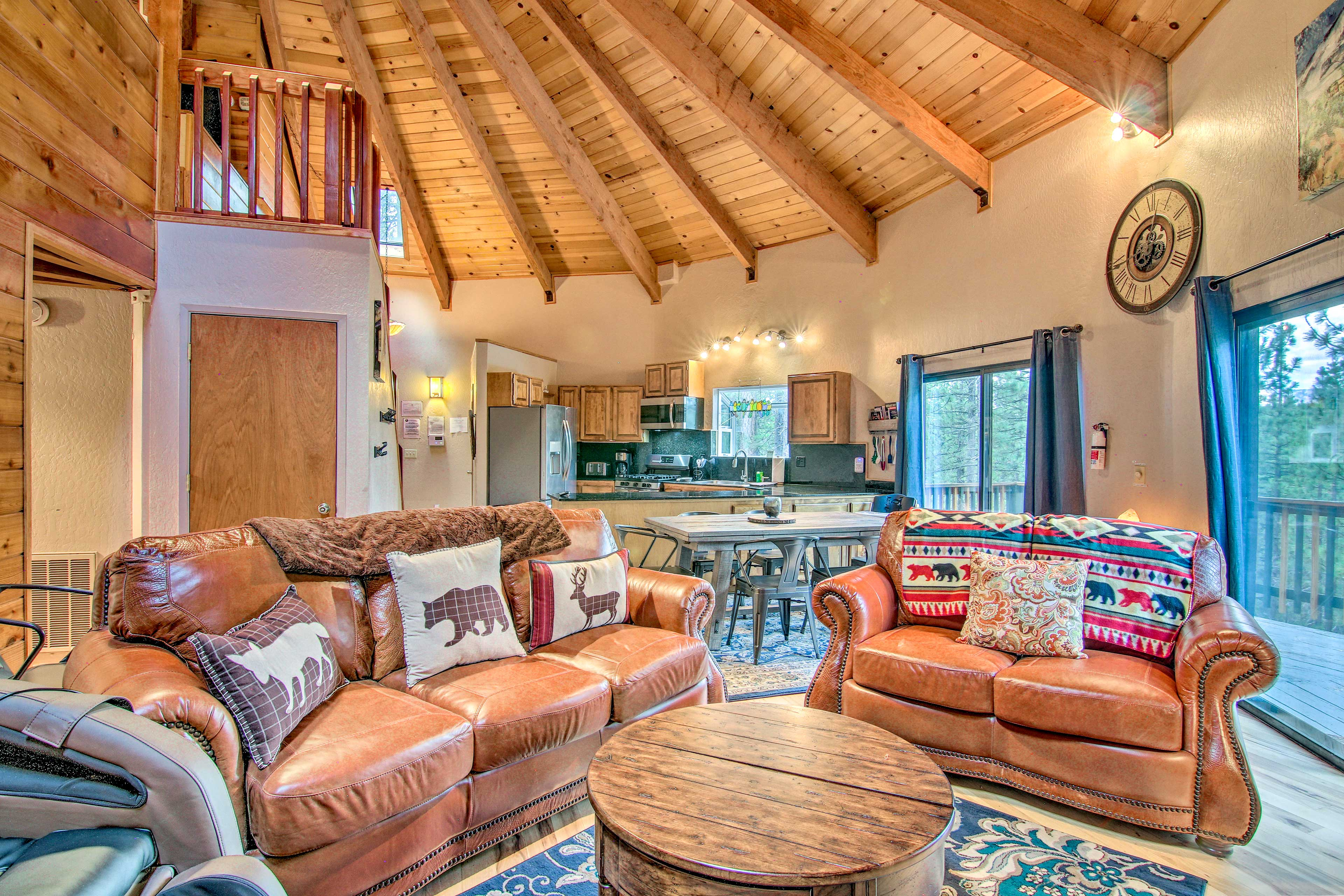 High ceilings and rustic details add to the cozy atmosphere in the living area.