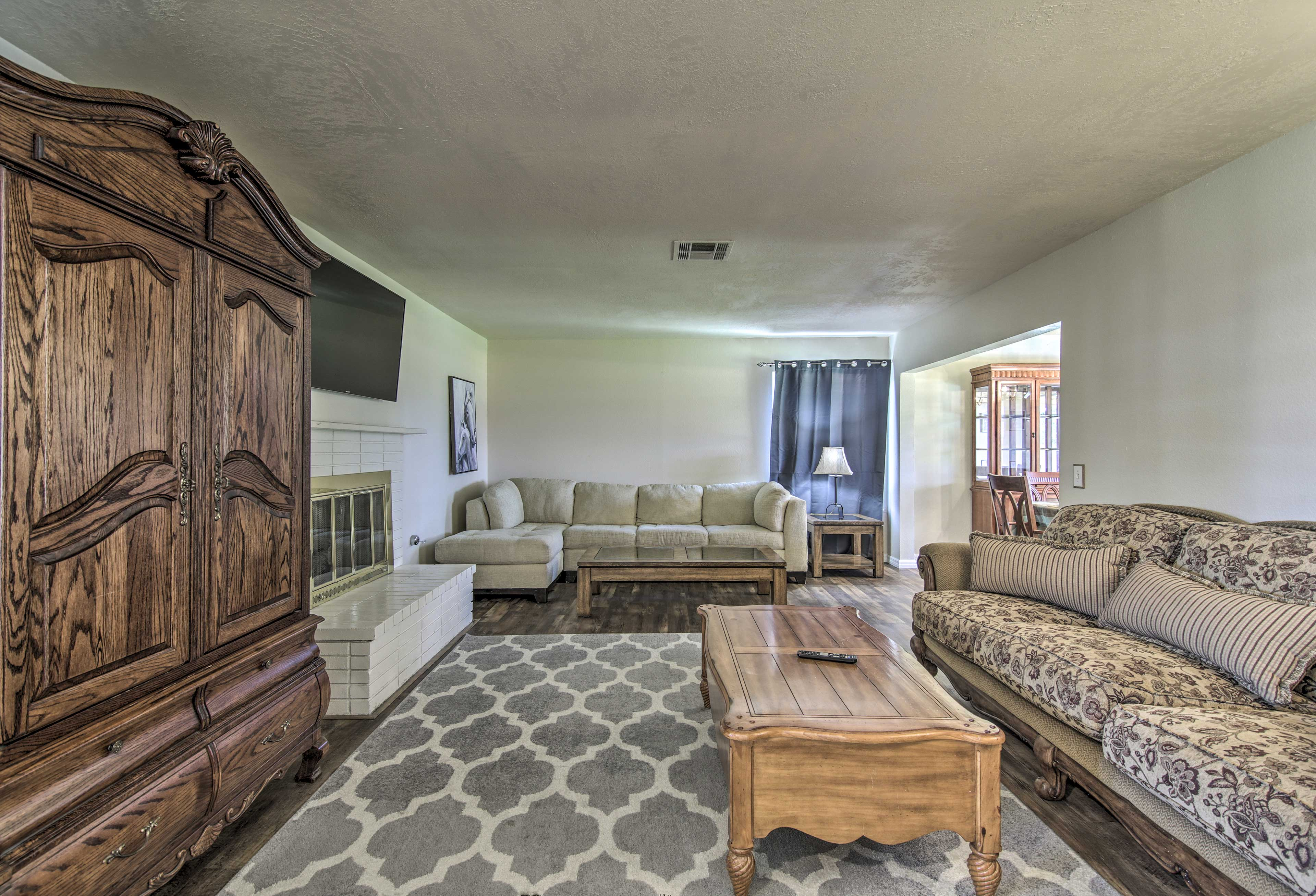 The living room features a wood-burning fireplace and flat-screen TV.