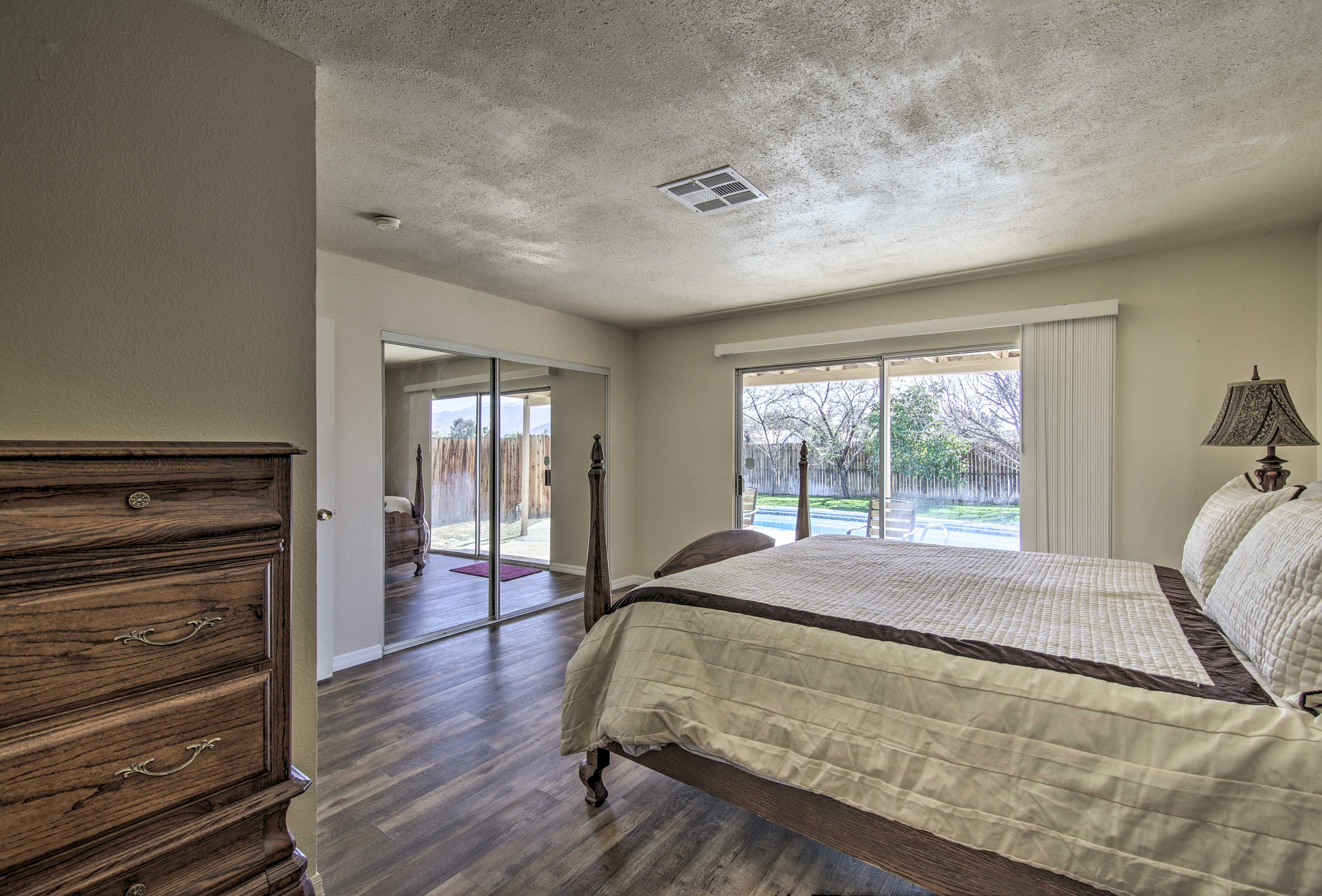 This bedroom grants direct access to the patio!