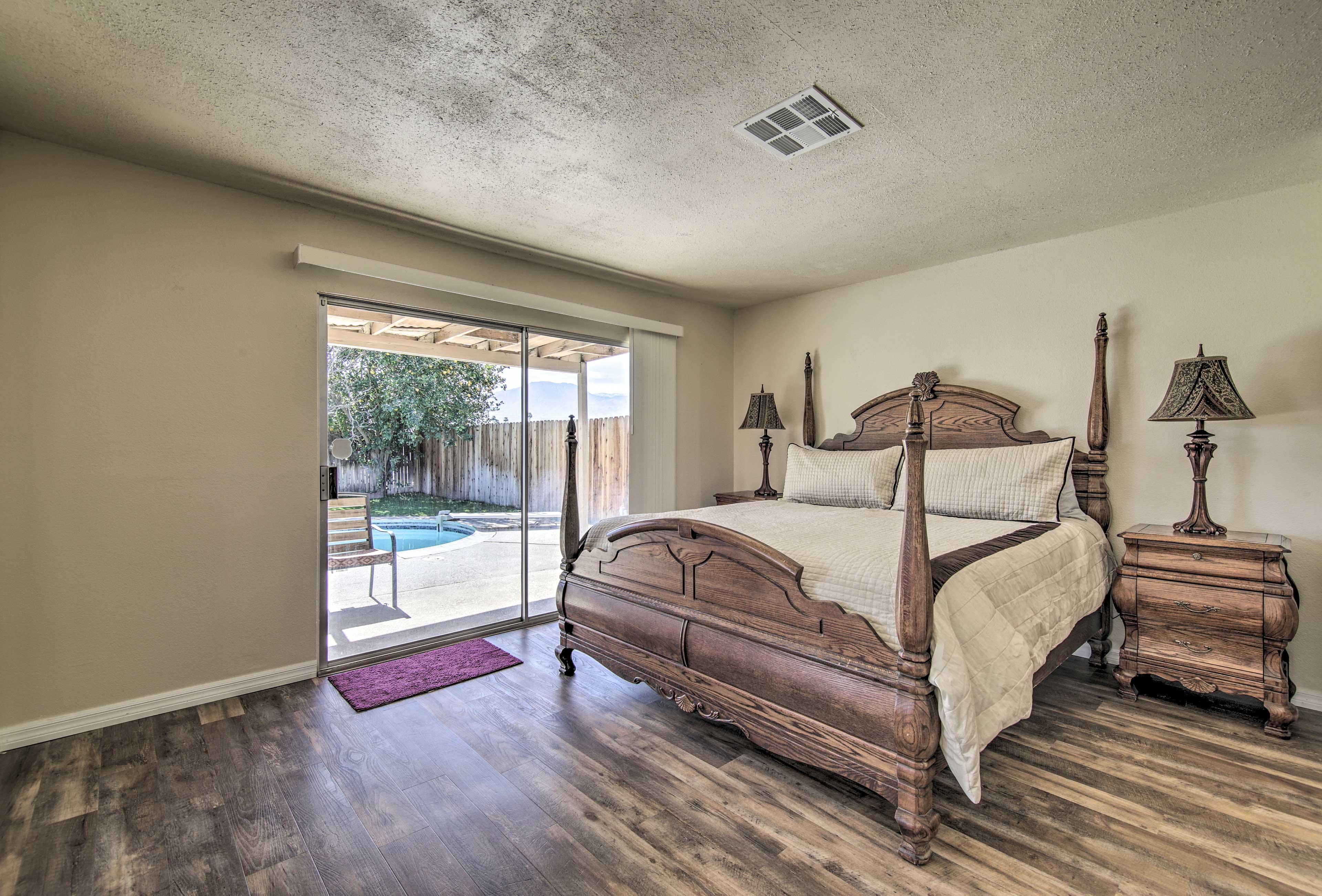 The master bedroom boasts an impressive California king bed.