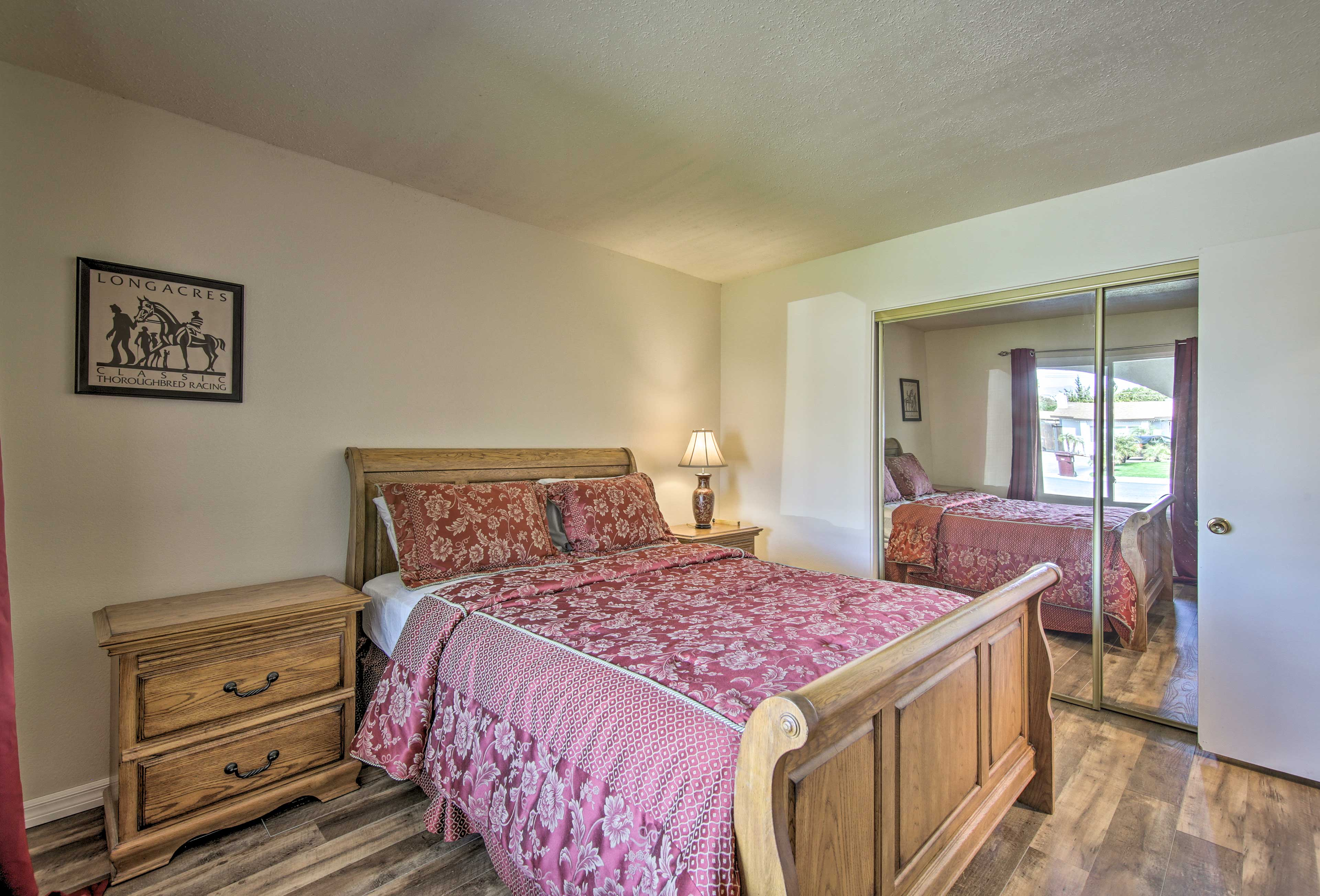 The second bedroom is complete with a queen-sized bed.
