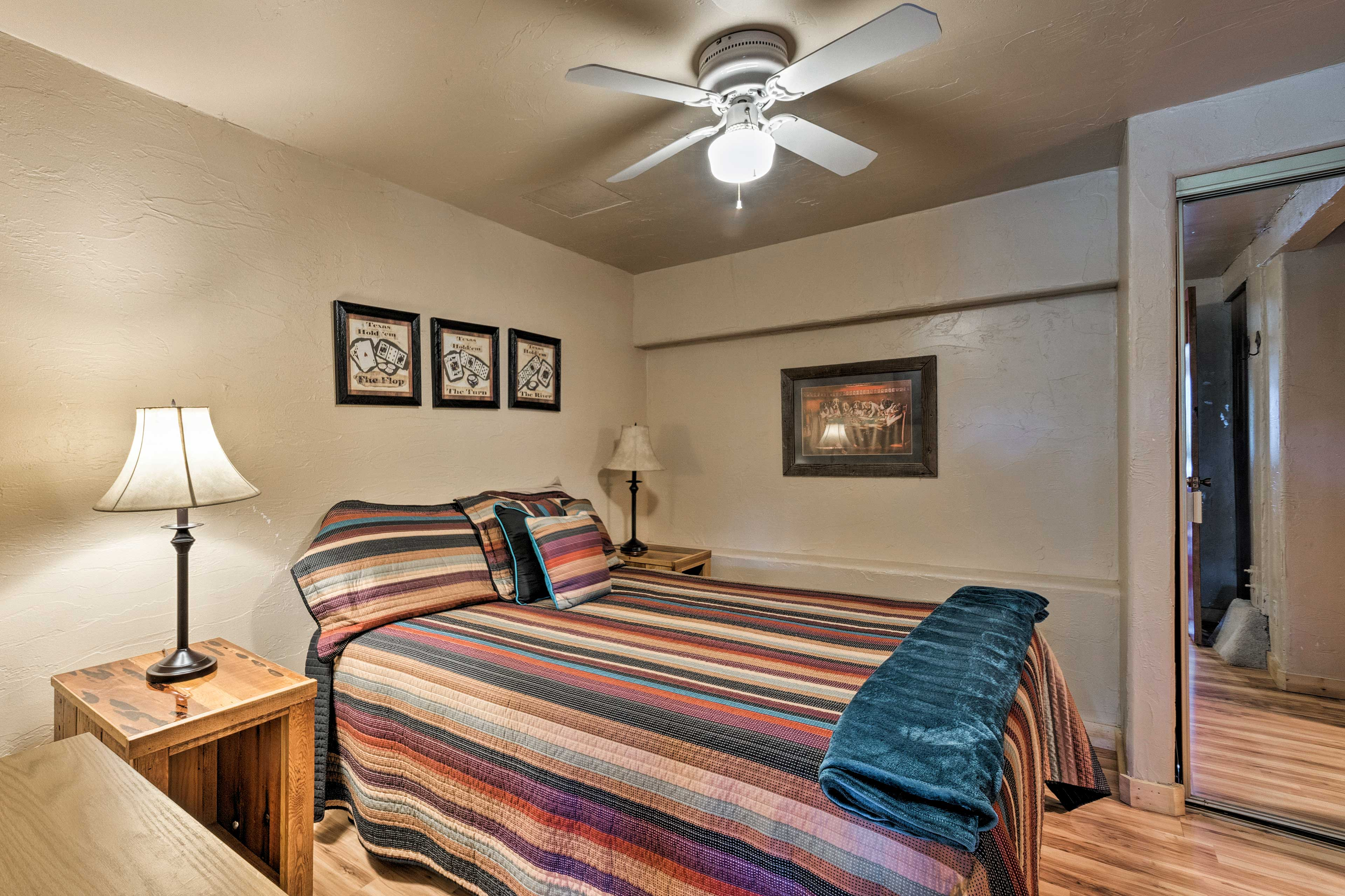 Turn on the ceiling fan and drift to sleep in this queen bed.